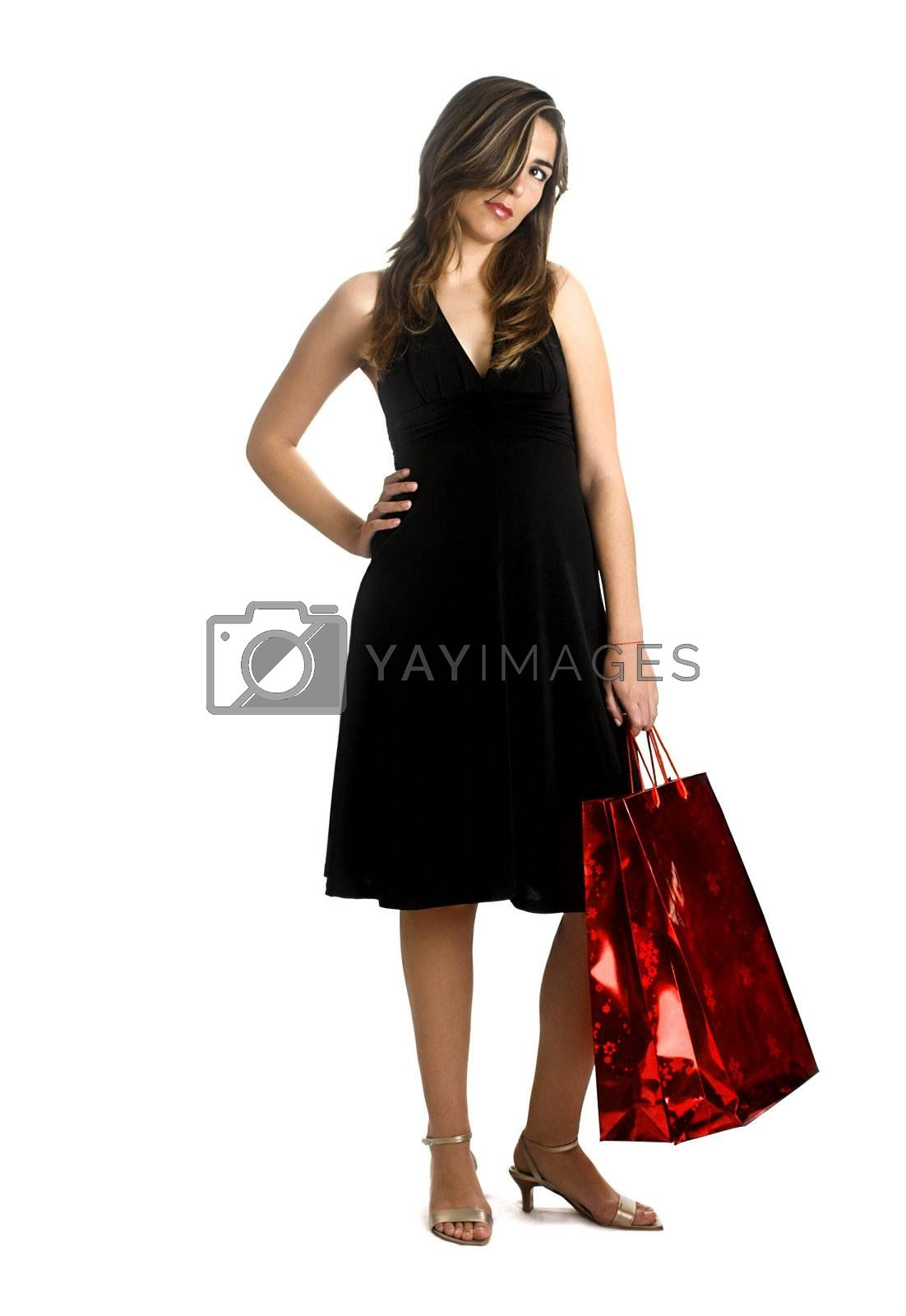 Beautiful woman isolated on a white background with a bag on the left hand.