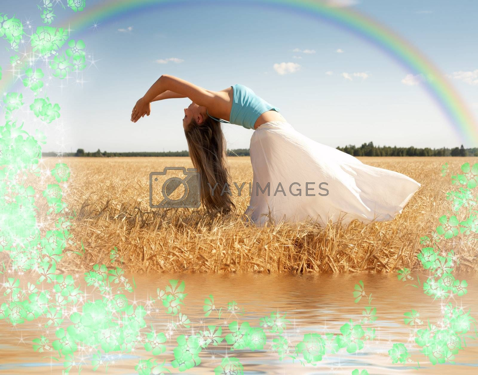 stretching woman in the meadow with rainbow, water and flowers