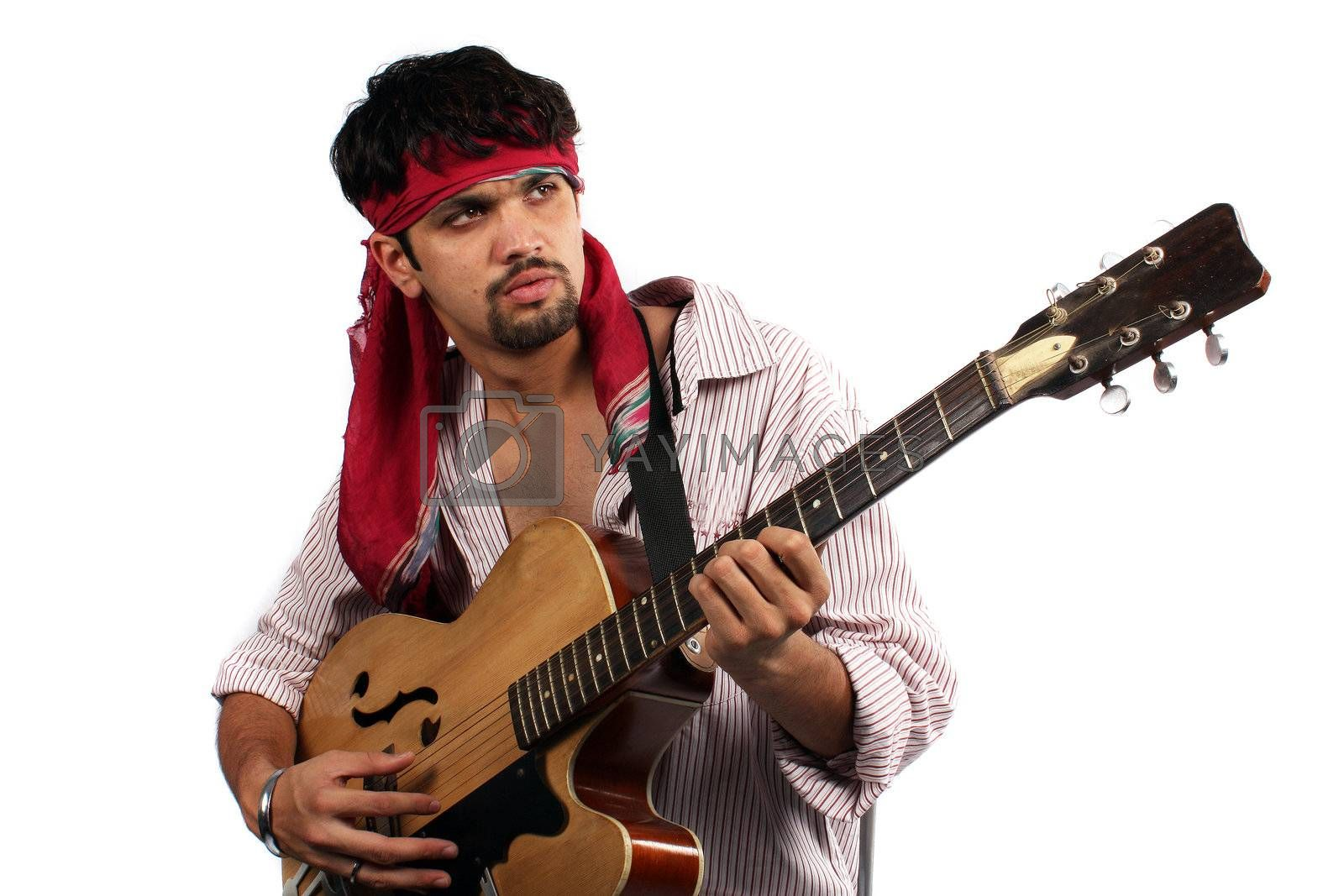 Royalty free image of Stylish Indian Guitarist by thefinalmiracle