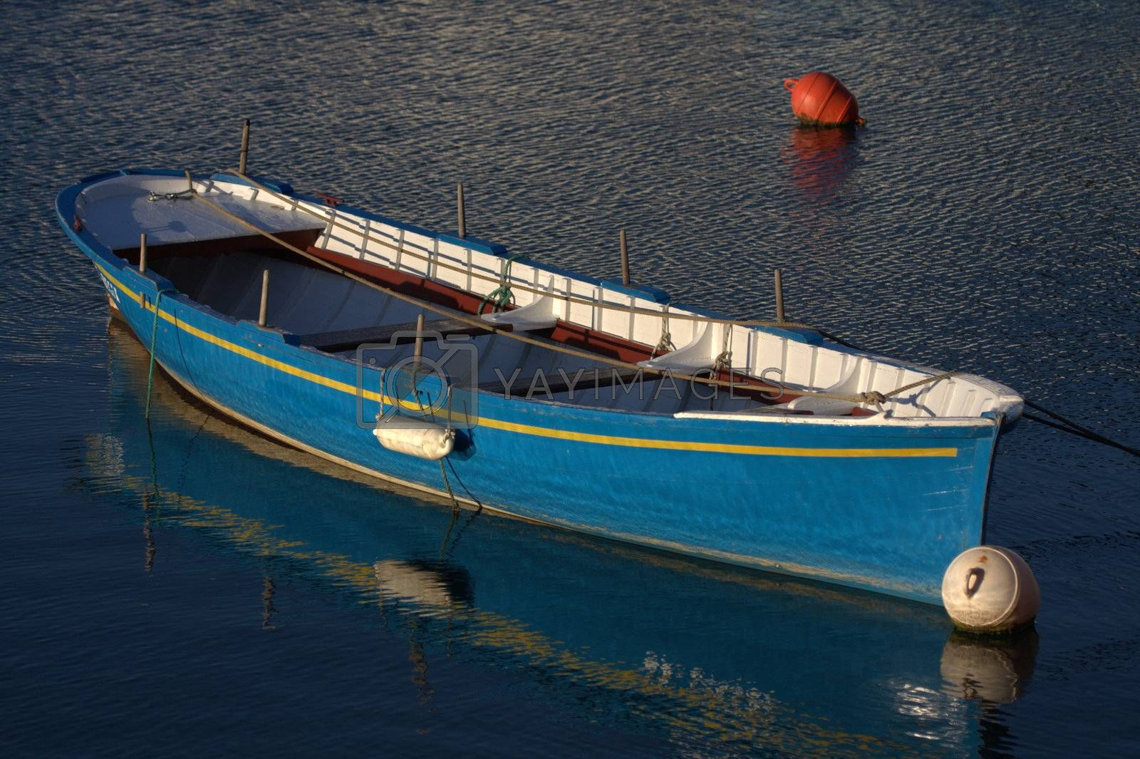 Royalty free image of a blue boat moored in the port by allg