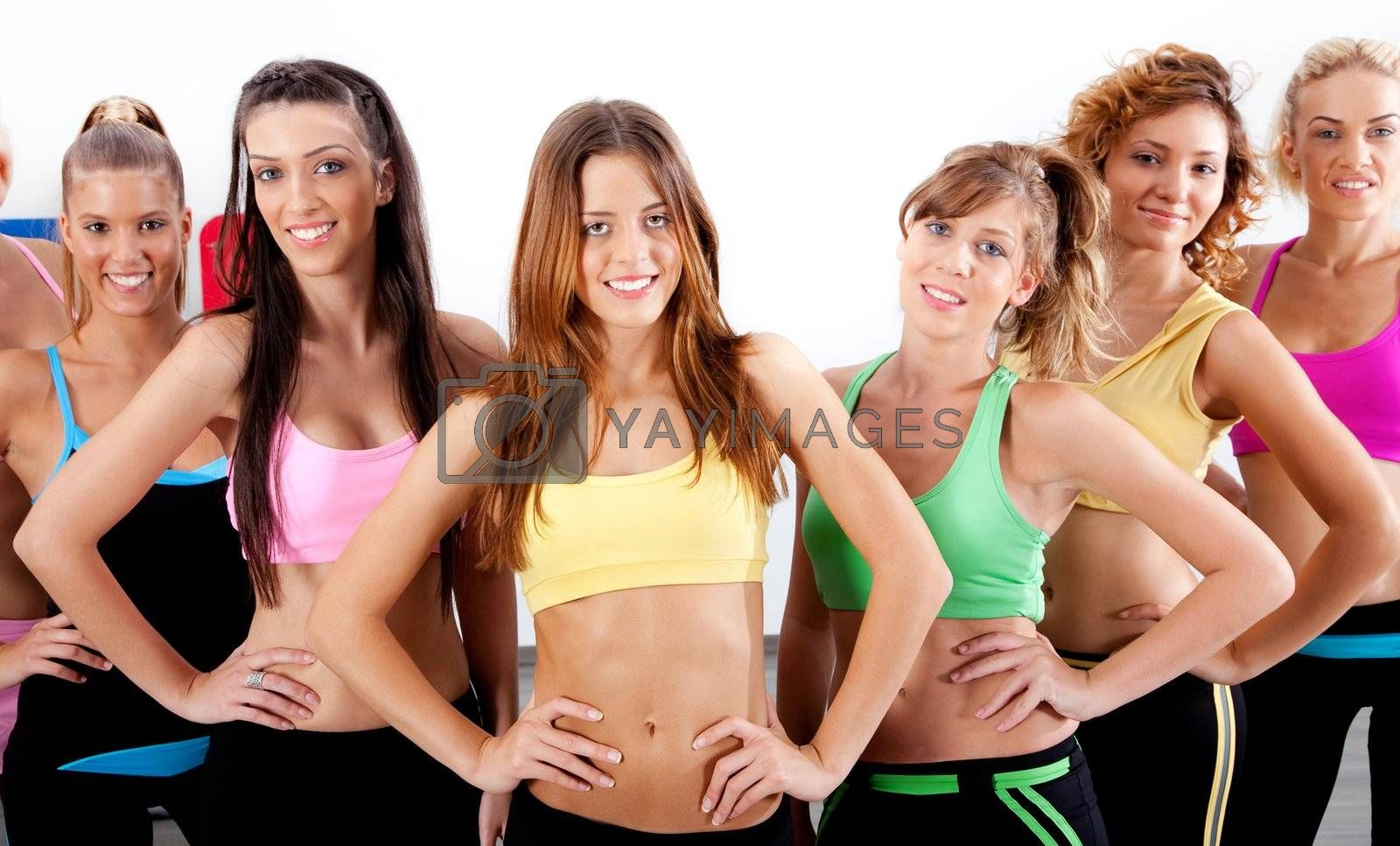 group of active ladies standing in front of camera
