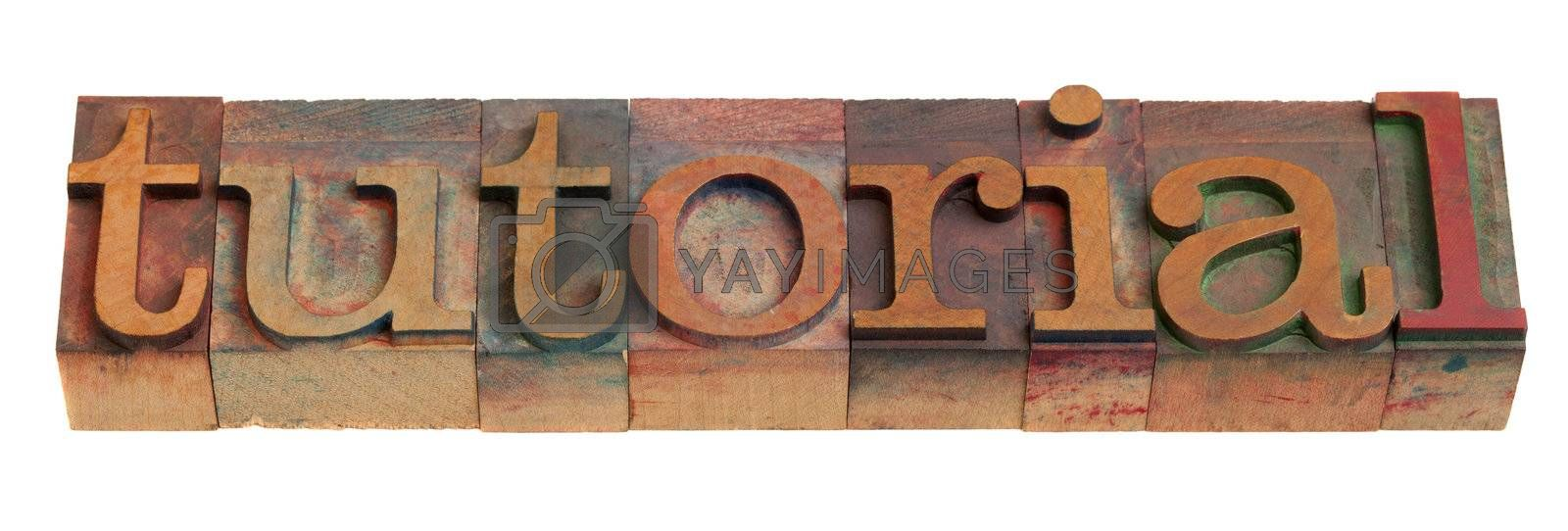 tutorial - word in vintage wooden letterpress printing blocks isolated on white