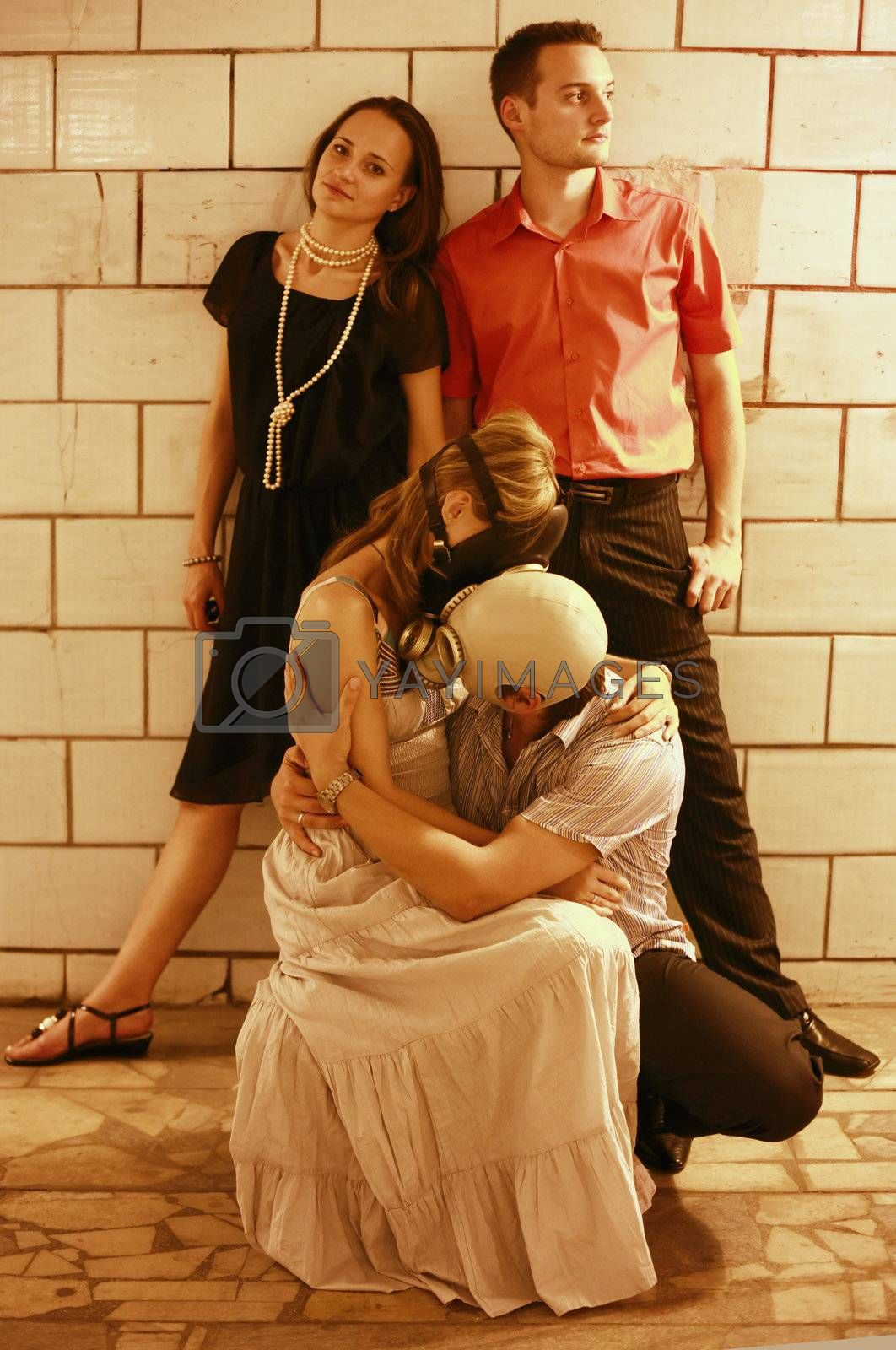 Two married couples in a tunnel one of pairs in gas masks