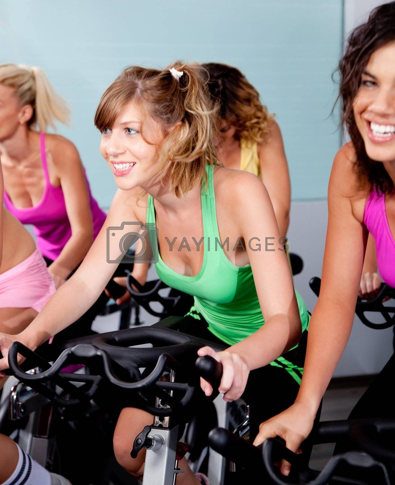 image of female cycling in fitness club