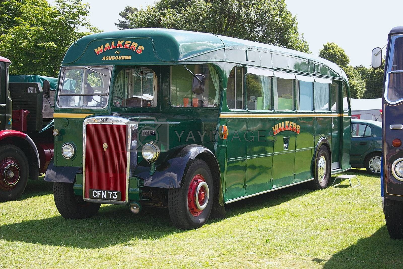 single decker green vintage bus