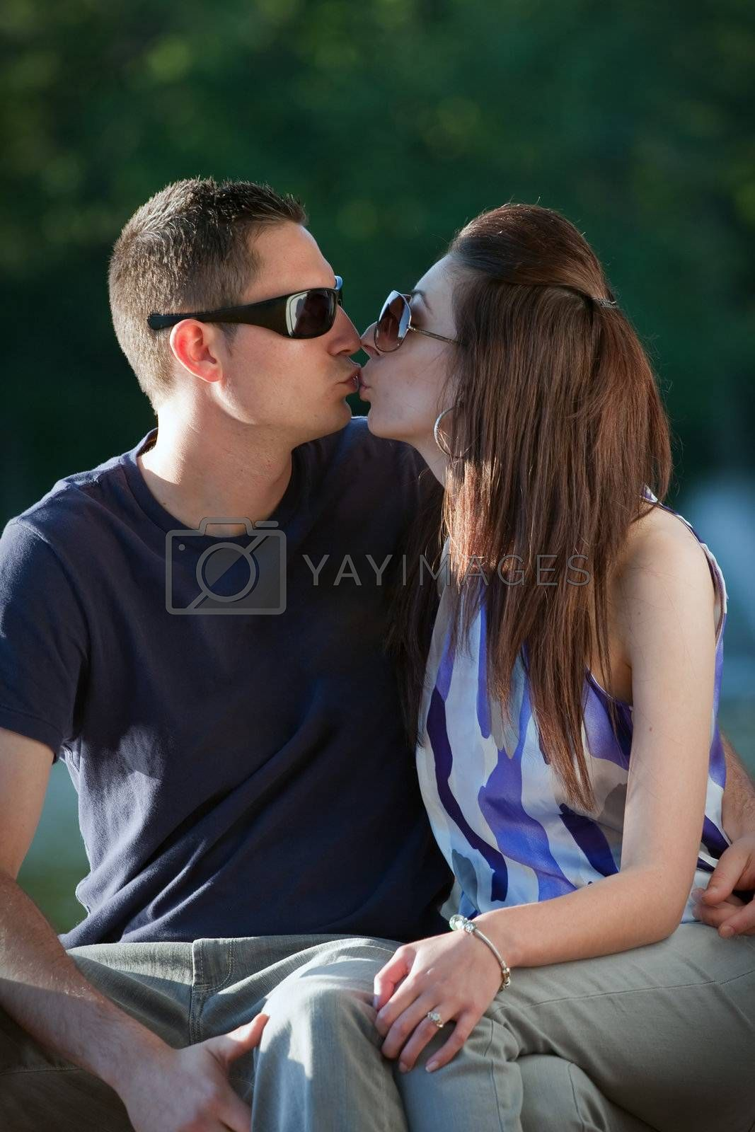 A young happy couple making out kissing.