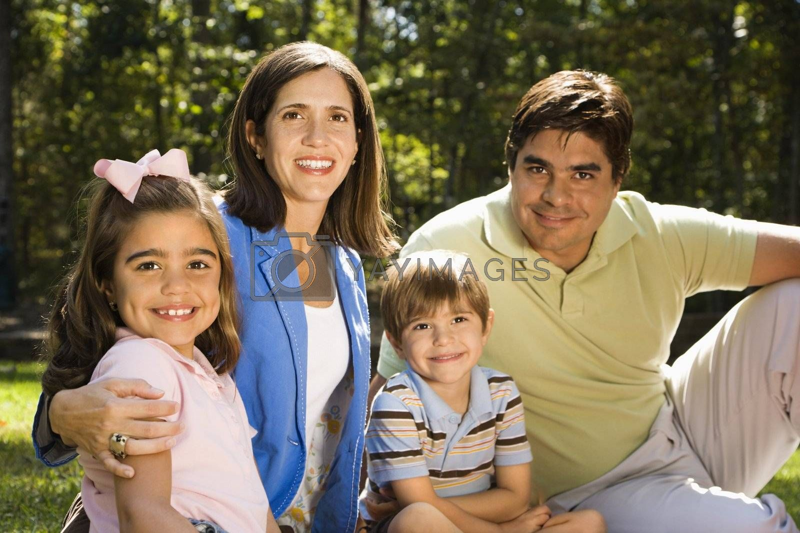 Hispanic outdoor family portrait.