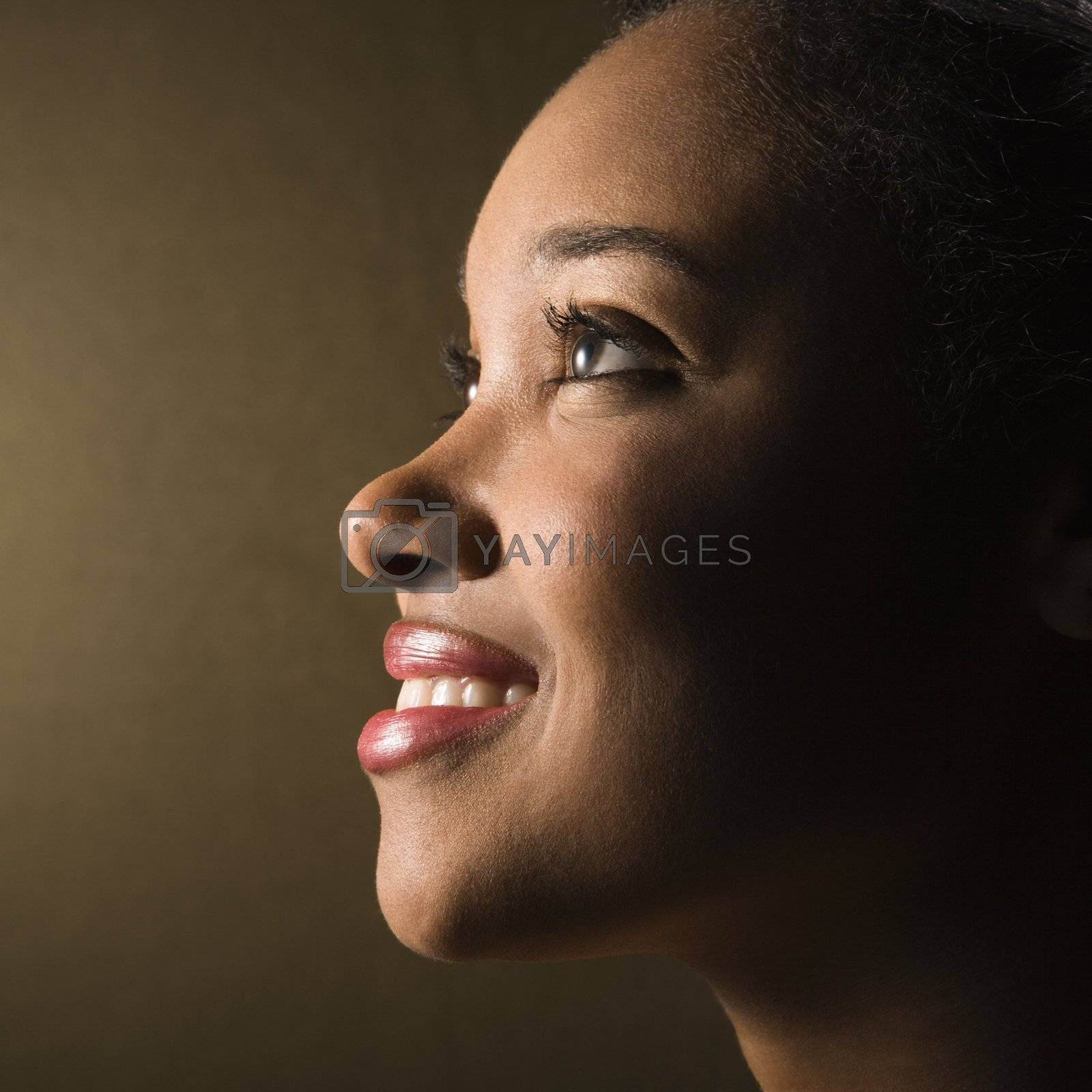Portrait of smiling African-American young adult female.