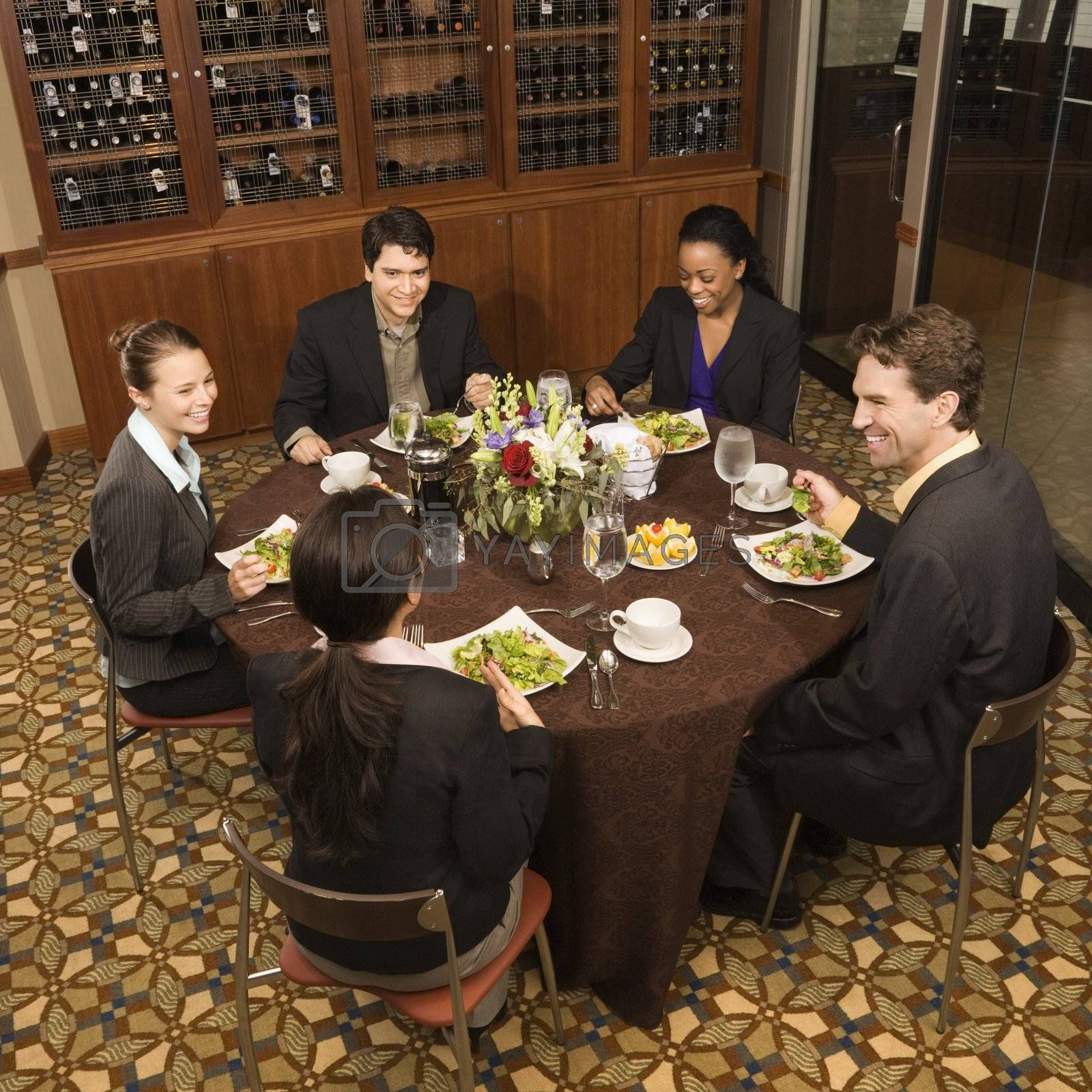 High angle of group of businesspeople in restaurant dining.