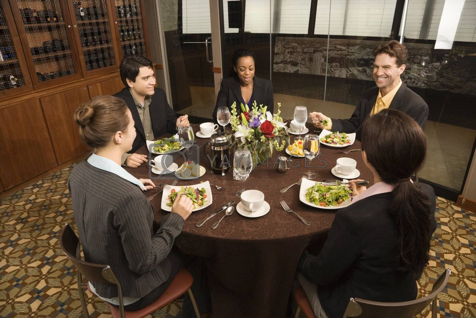 High angle of diverse group of businesspeople in restaurant eating.