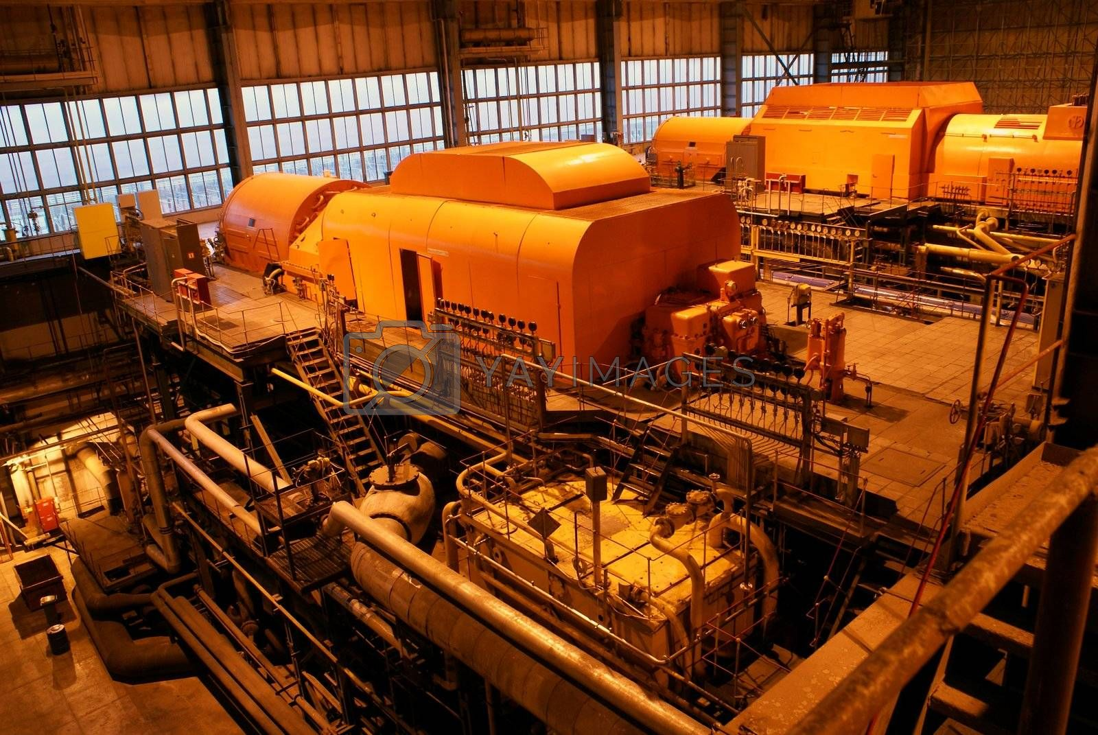 steam turbine and different size and shaped pipes at a power plant