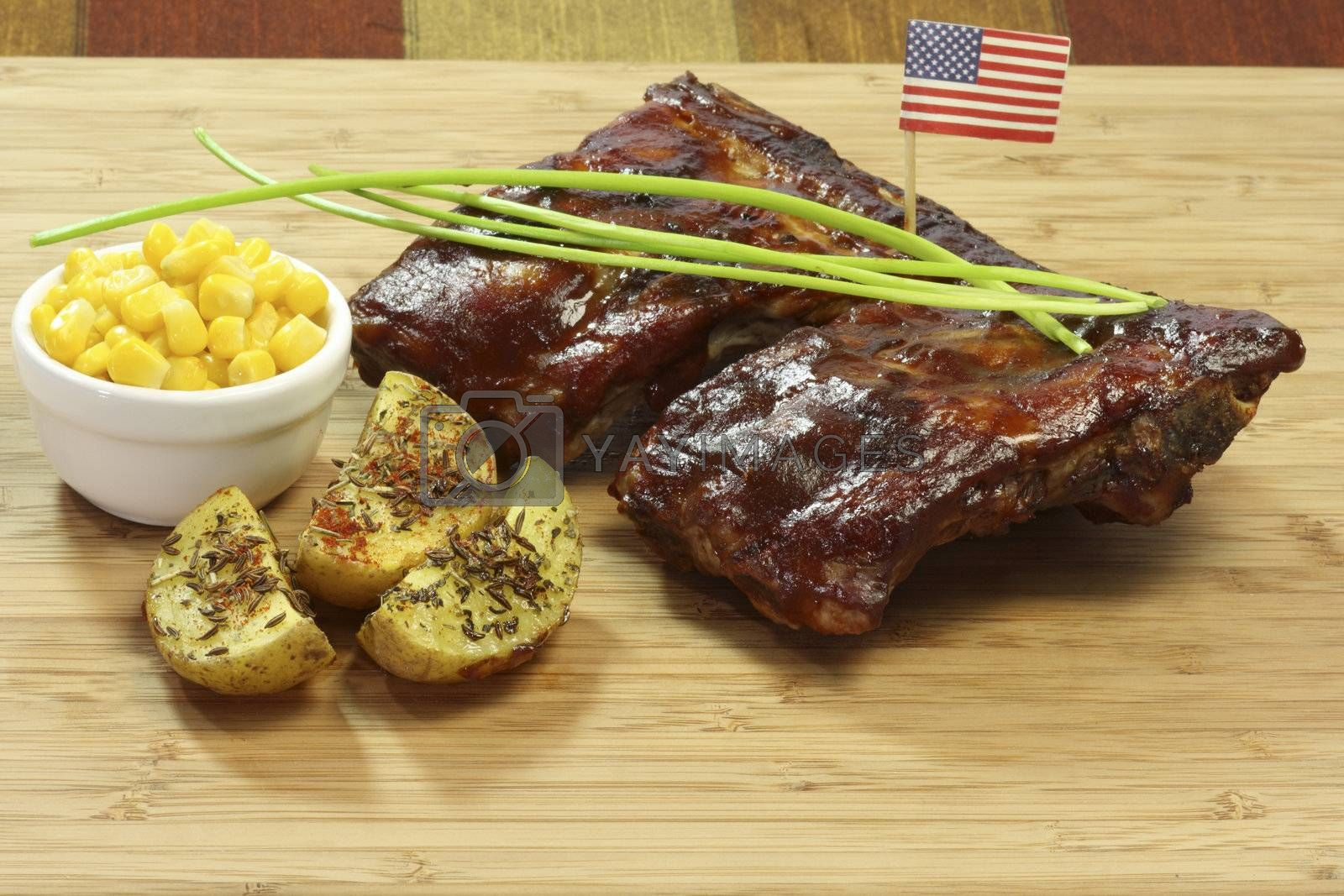 Grilled spare ribs with potatoes and corn