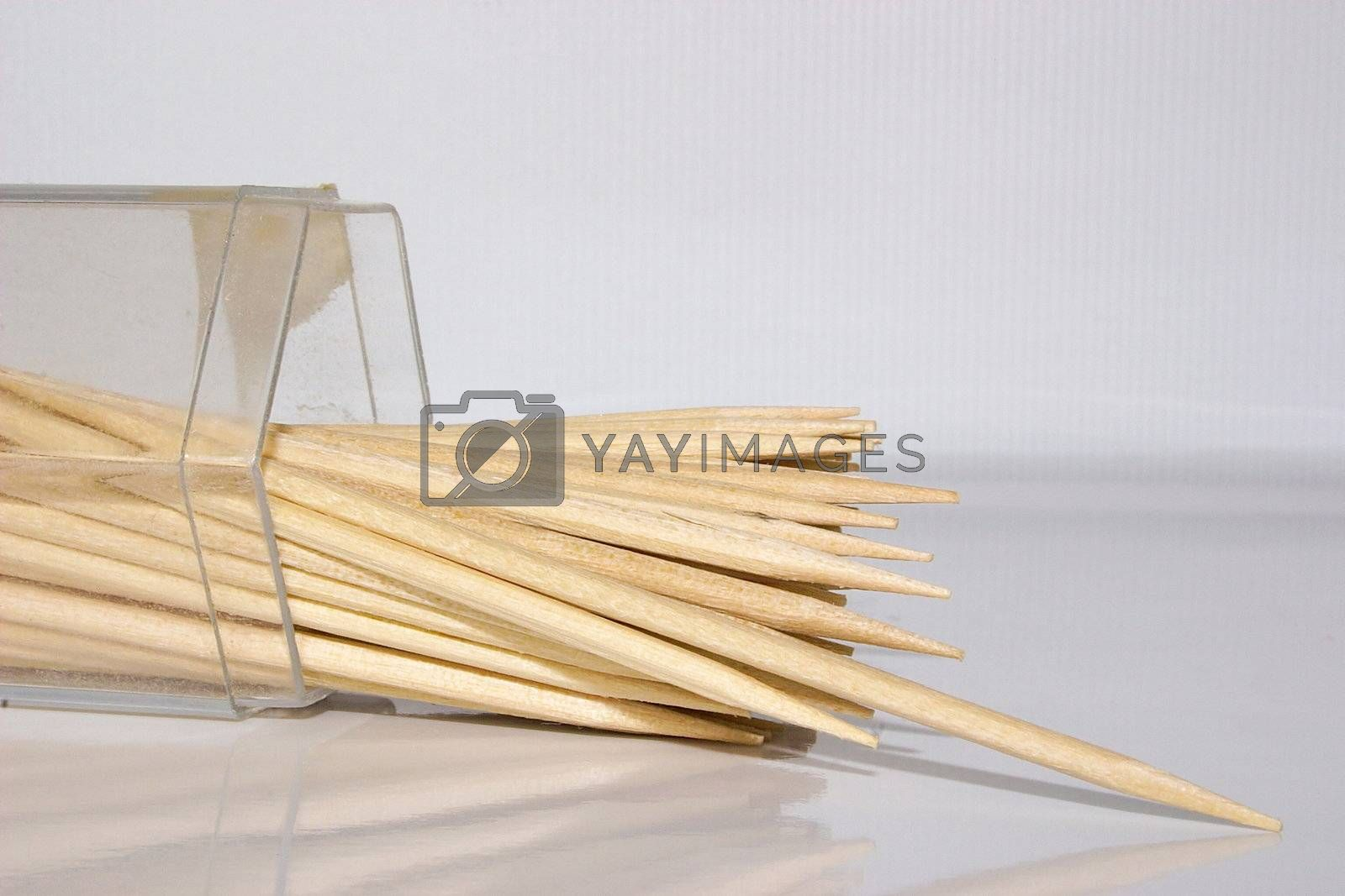 toothpicks which have fallen over in their container