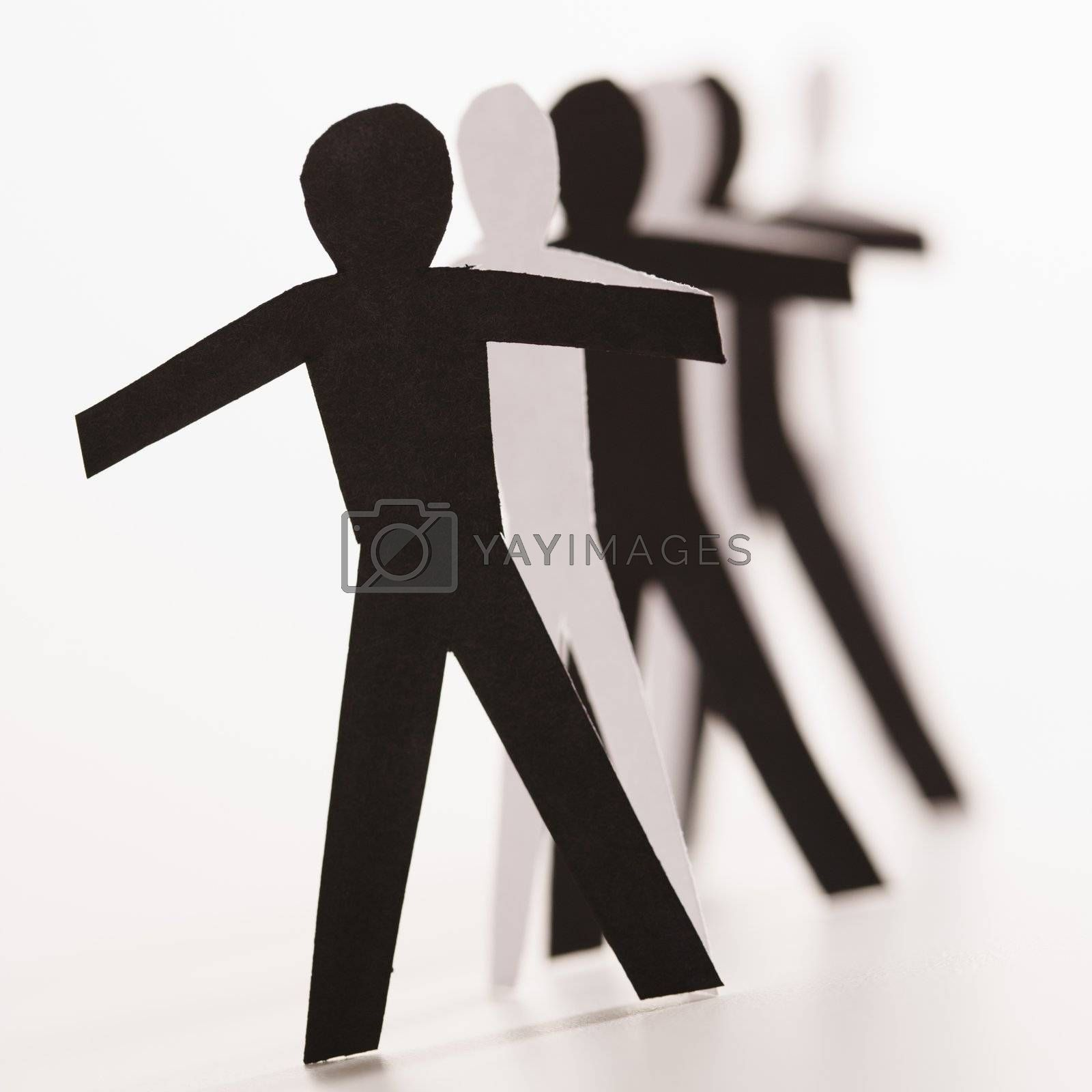 Black and white cutout paper people standing in line together.