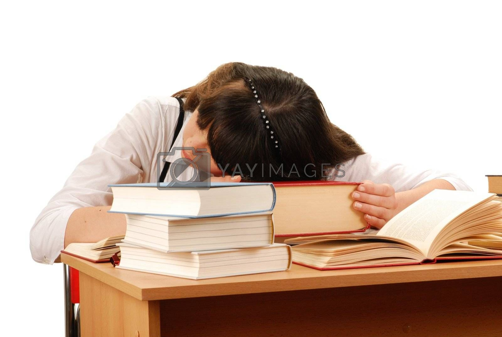 Tired girl sleeping on books isolated on white