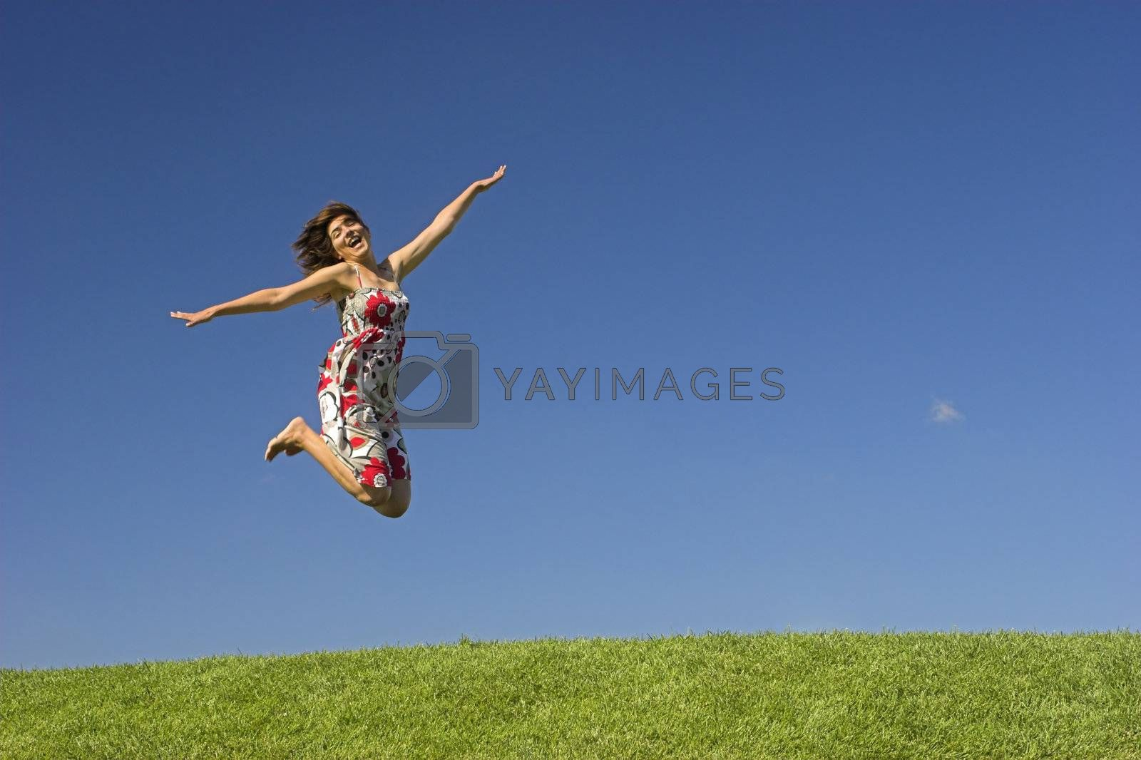 Happy woman on a beautiful green meadow