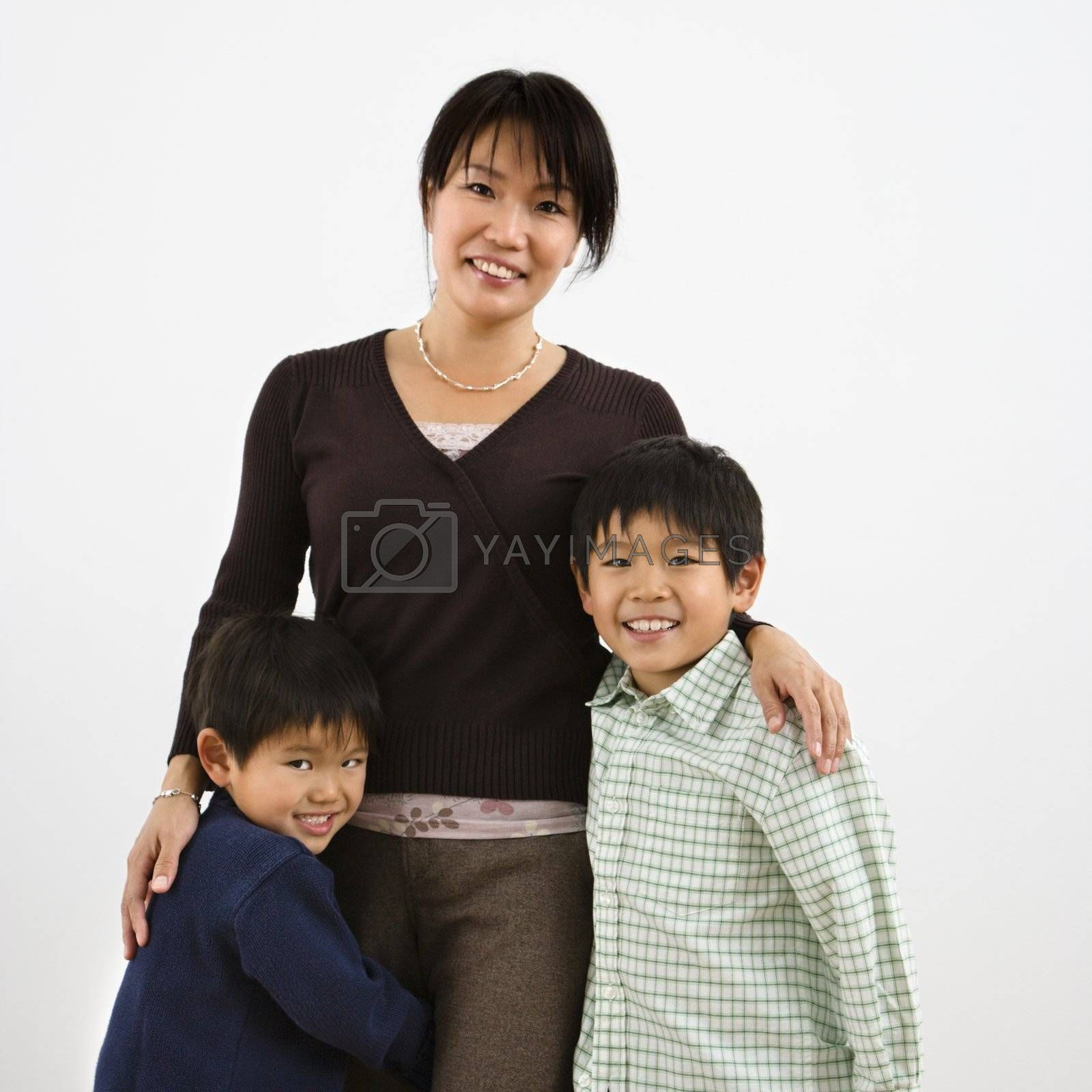 Portrait of Asian mother with two young sons.