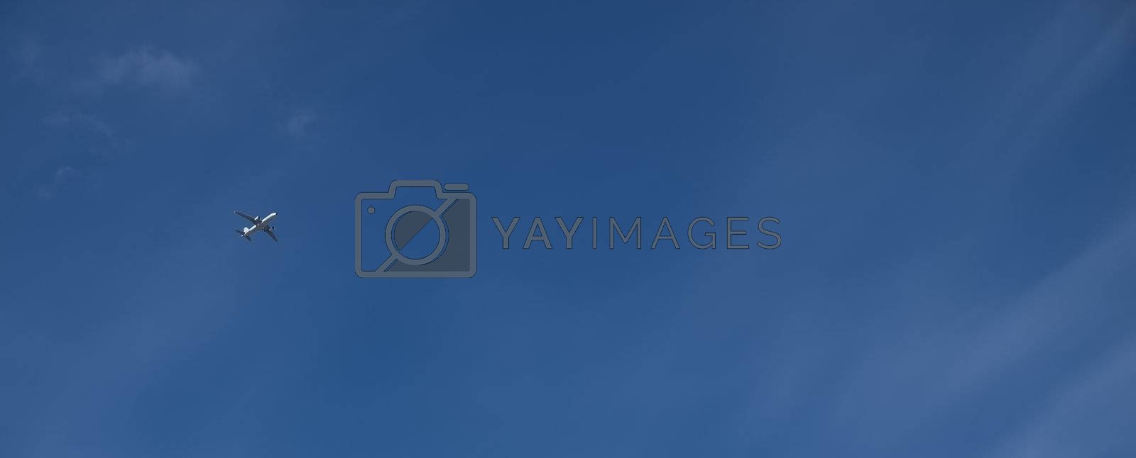 Conceptual image showing civil airliner over blue sky