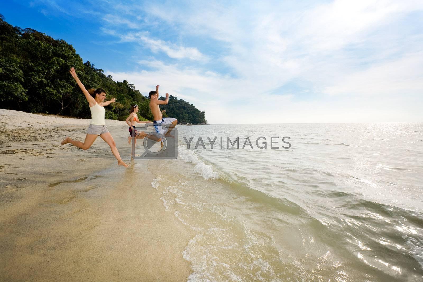 happy friends having fun by the beach by eyedear