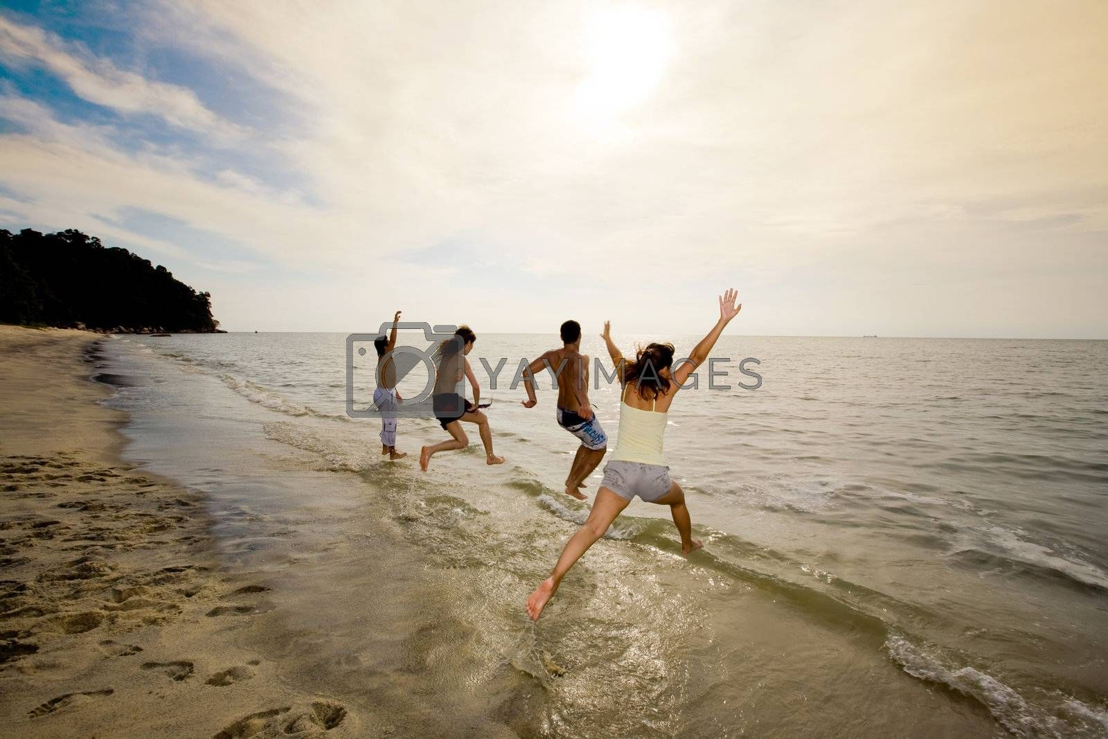 group of friends jumping into the sea by eyedear