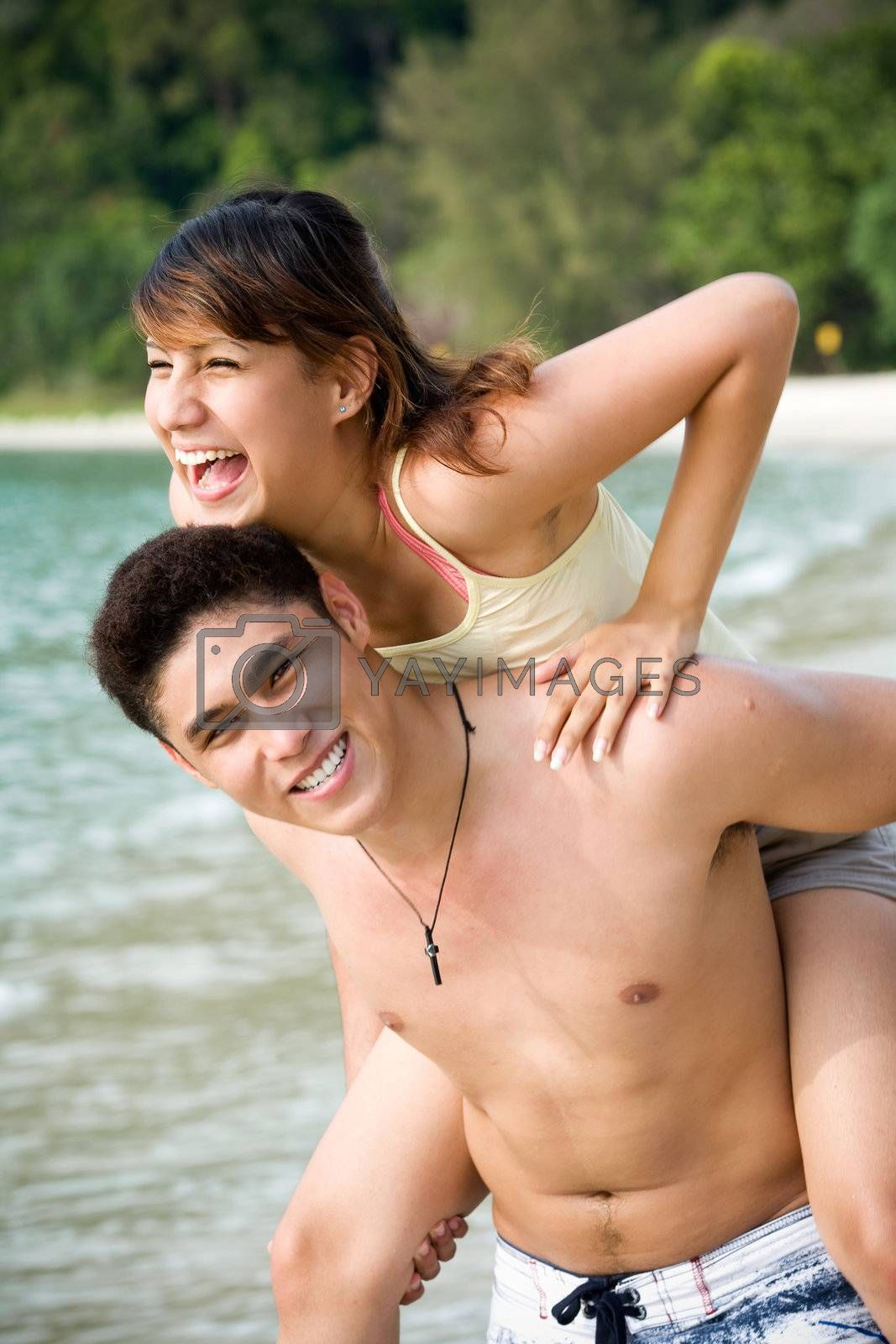 copule having fun on the beach by eyedear