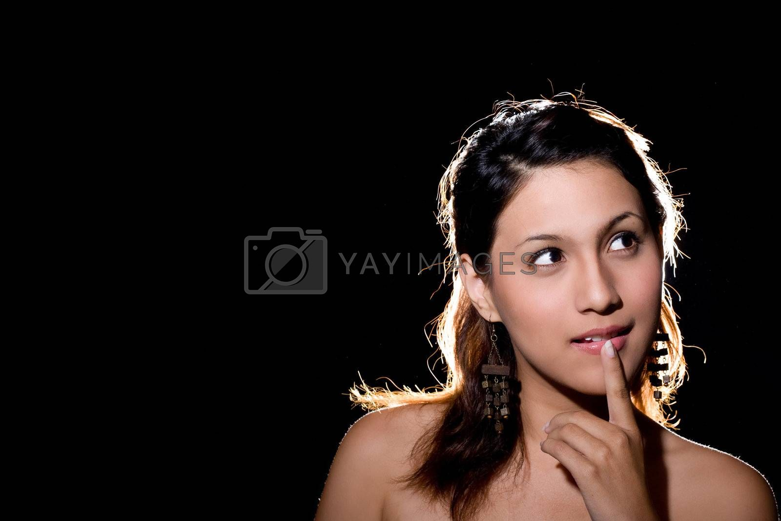 young woman smiling with a thought of an idea or solution