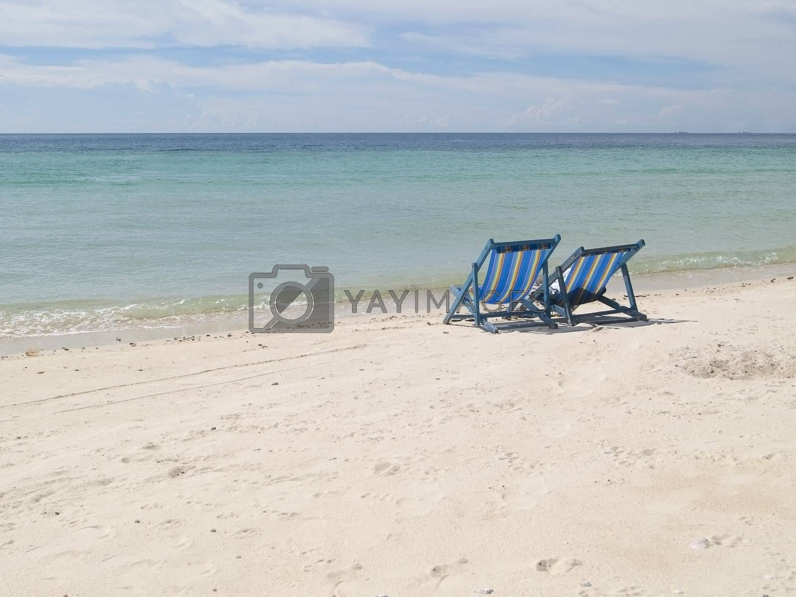 Two chairs on the beach by epixx