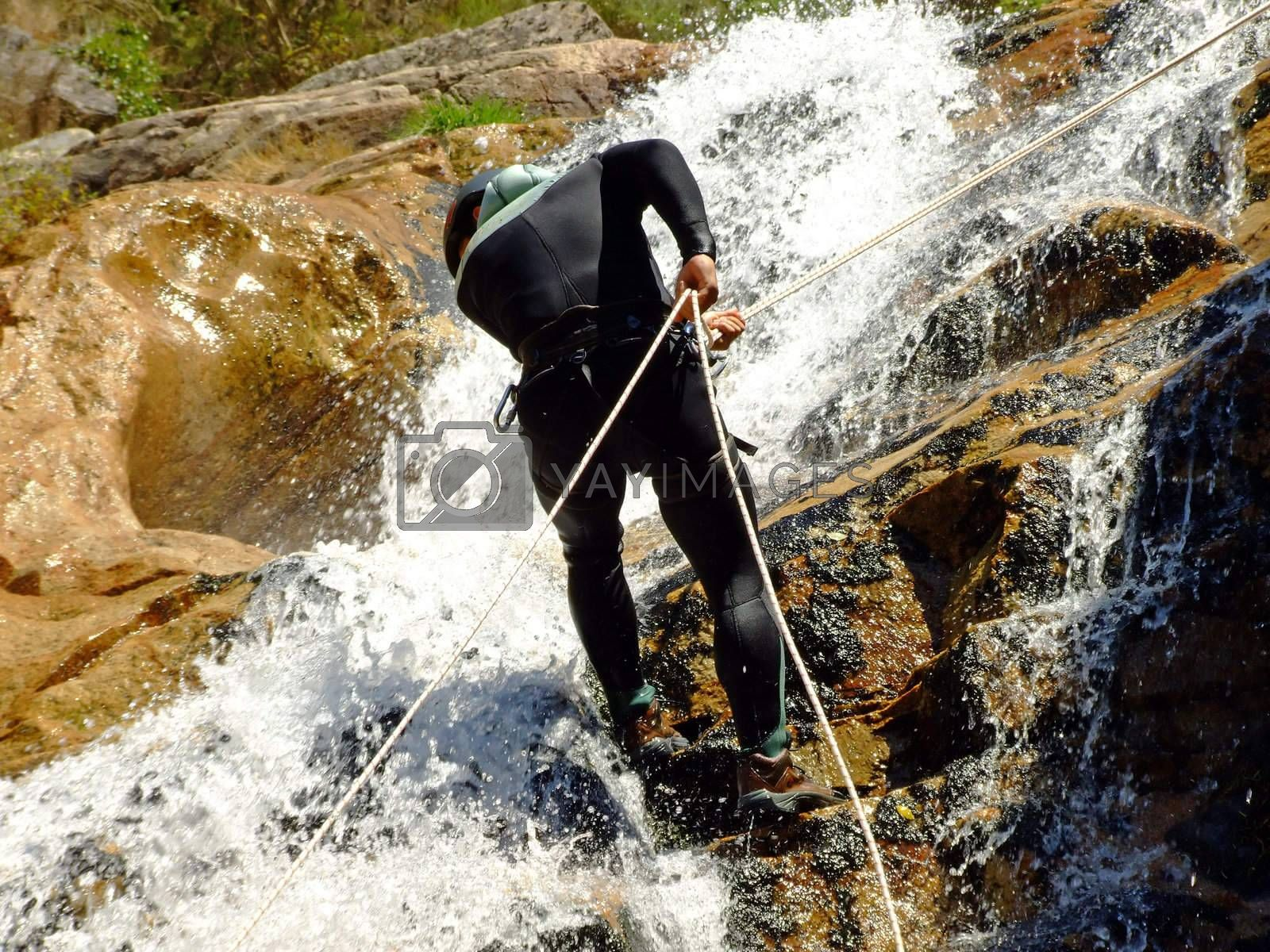 Men descending on rappel by PauloResende
