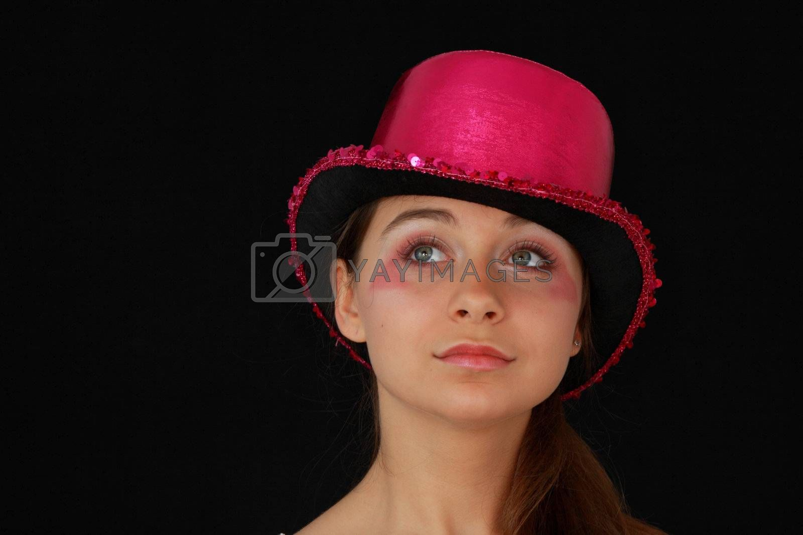 Portrait of a beautiful young girl in pink disco hat - carnival theme