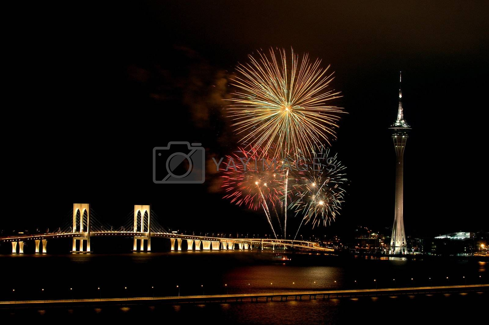 Celebration of New Year in Macau with fireworks beside the Tower Convention and Sai Van bridge