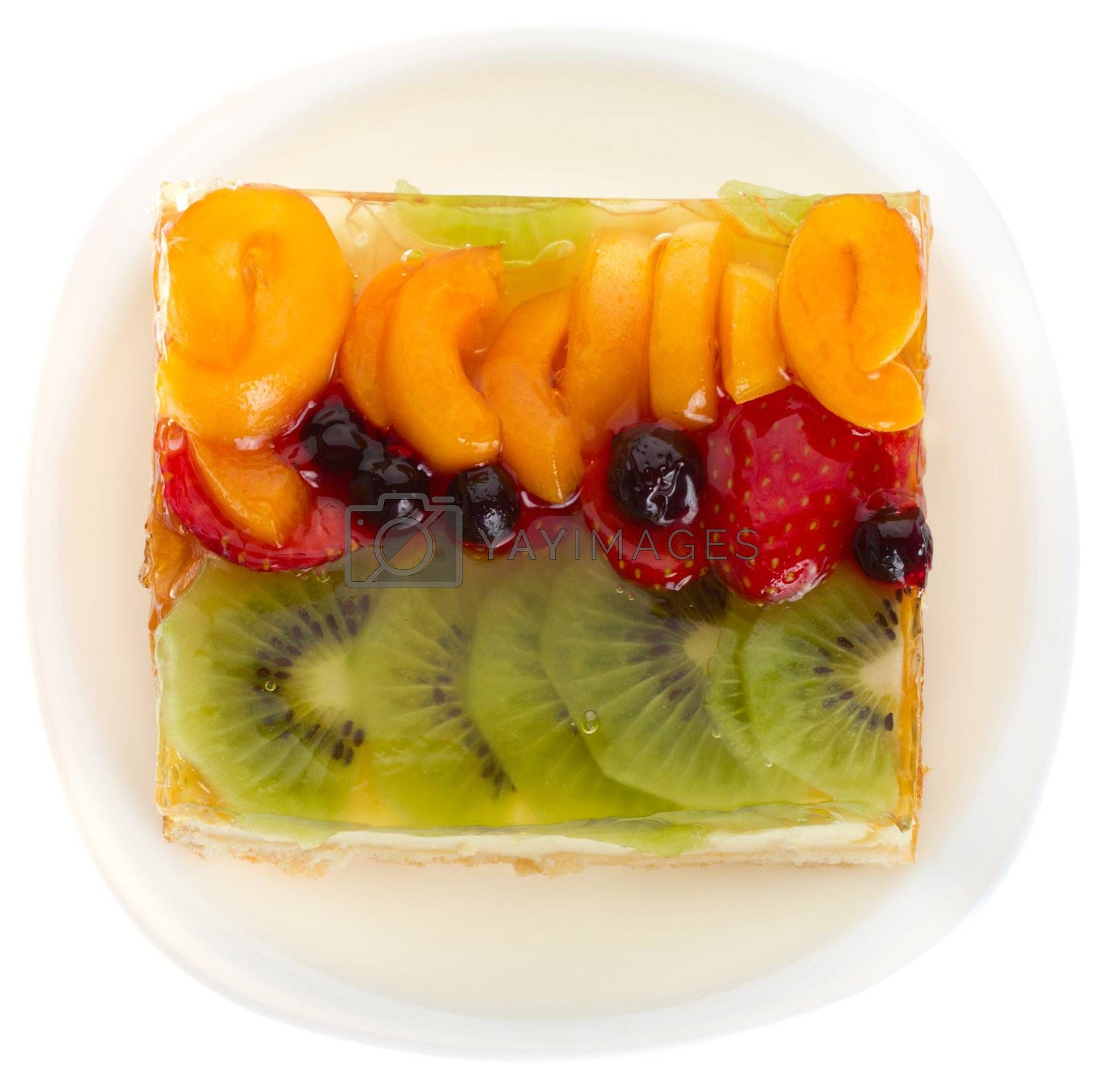 close-up curd cake with jellied fruits and berries, isolated on white