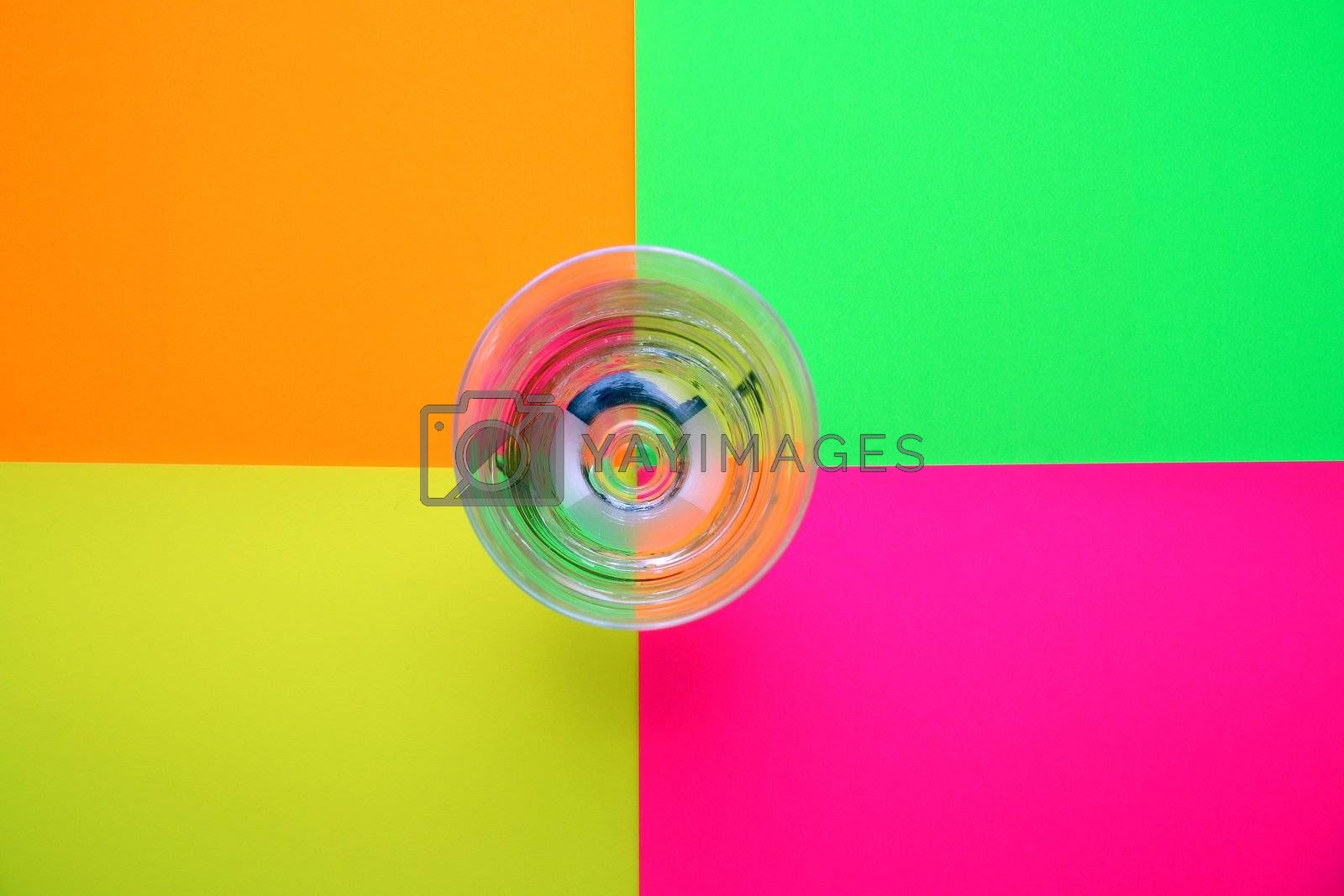 glass of water over colored background