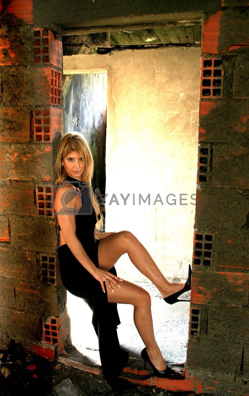 Sexy fashion girl in old building