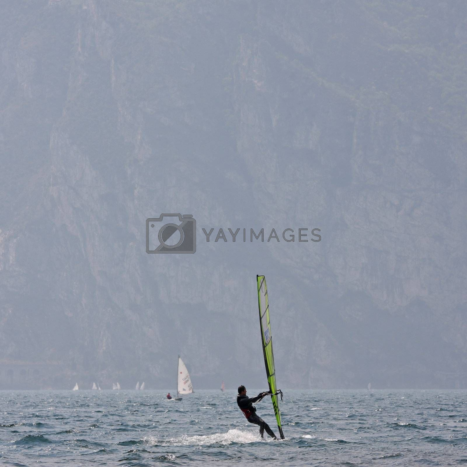 wind surfer at garda lake in italy by bernjuer