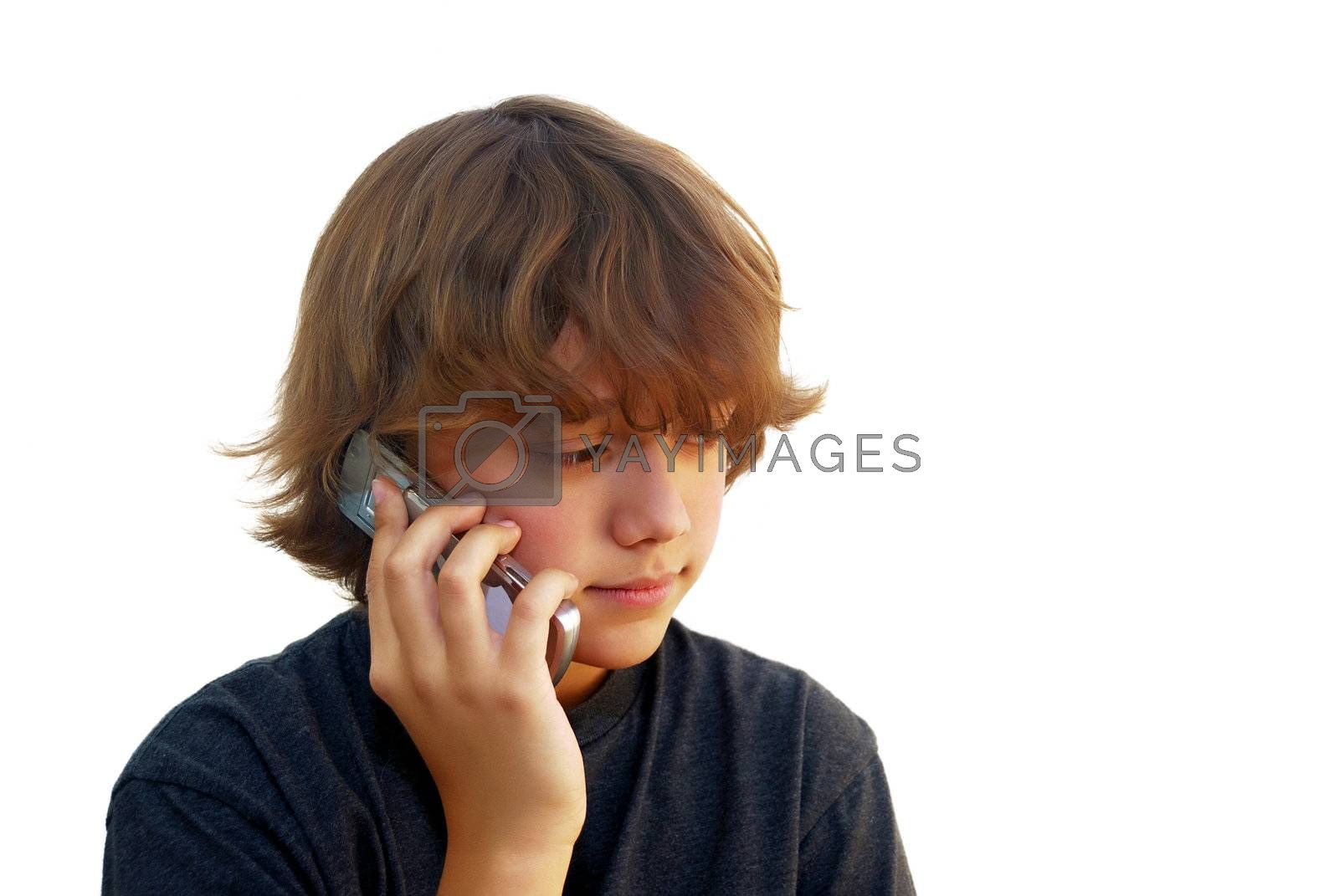 Teen boy talking on mobile phone isolated on white background.