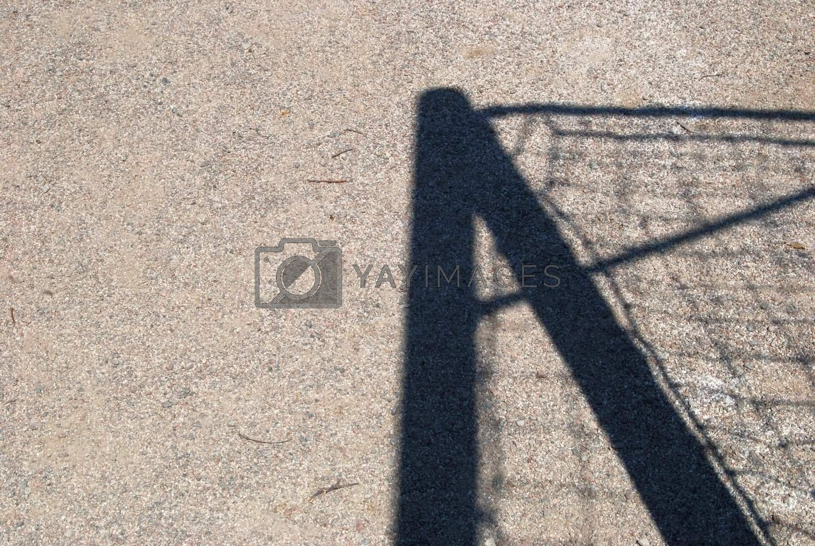 Shadow in the sand by windmill