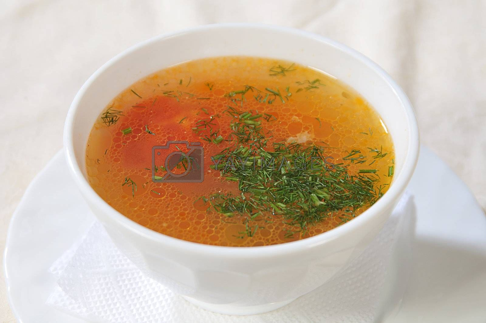 white bowl with soup, strewed dill