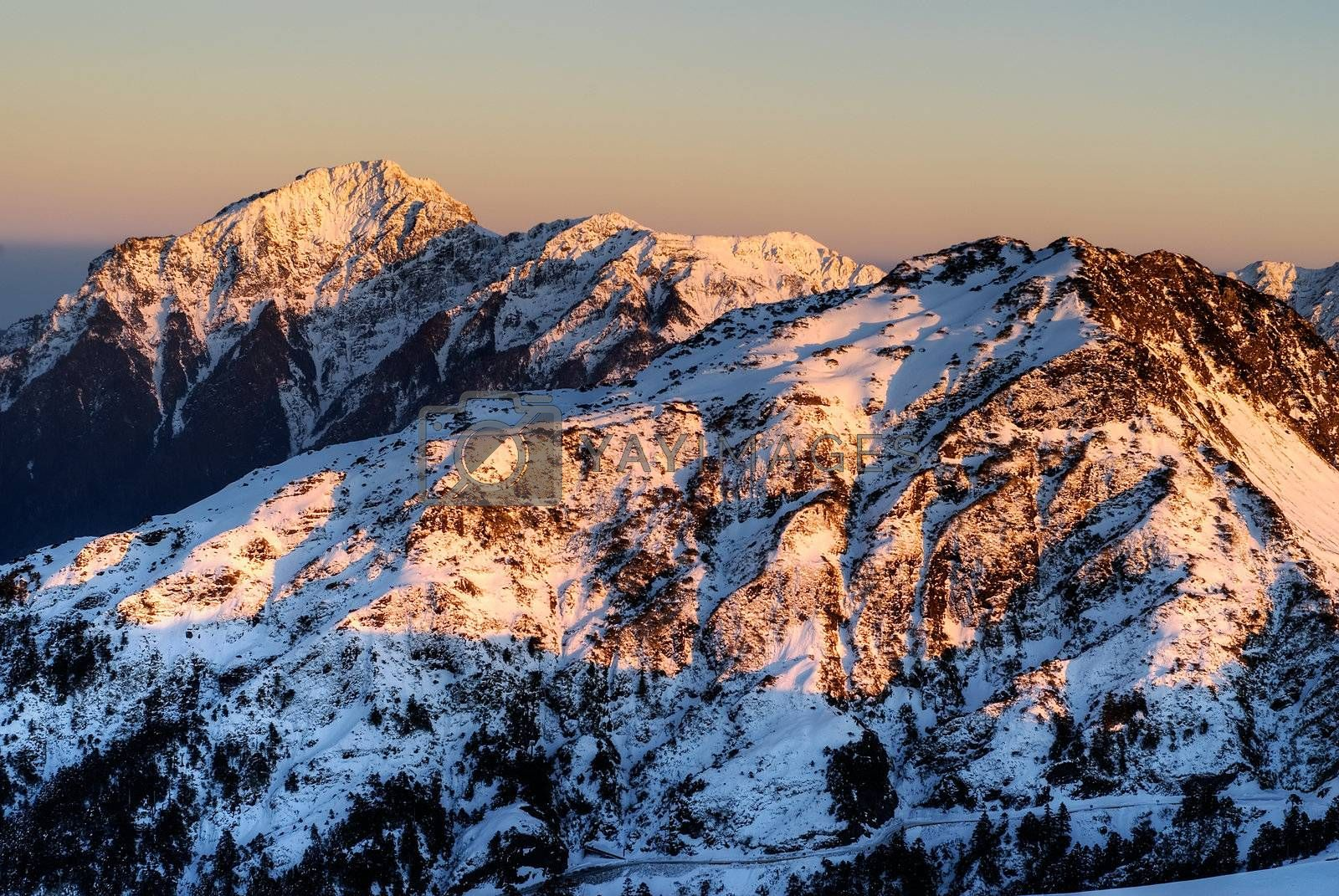 Landscape of snow mountain in sunset with golden color in Taiwan, Asia.