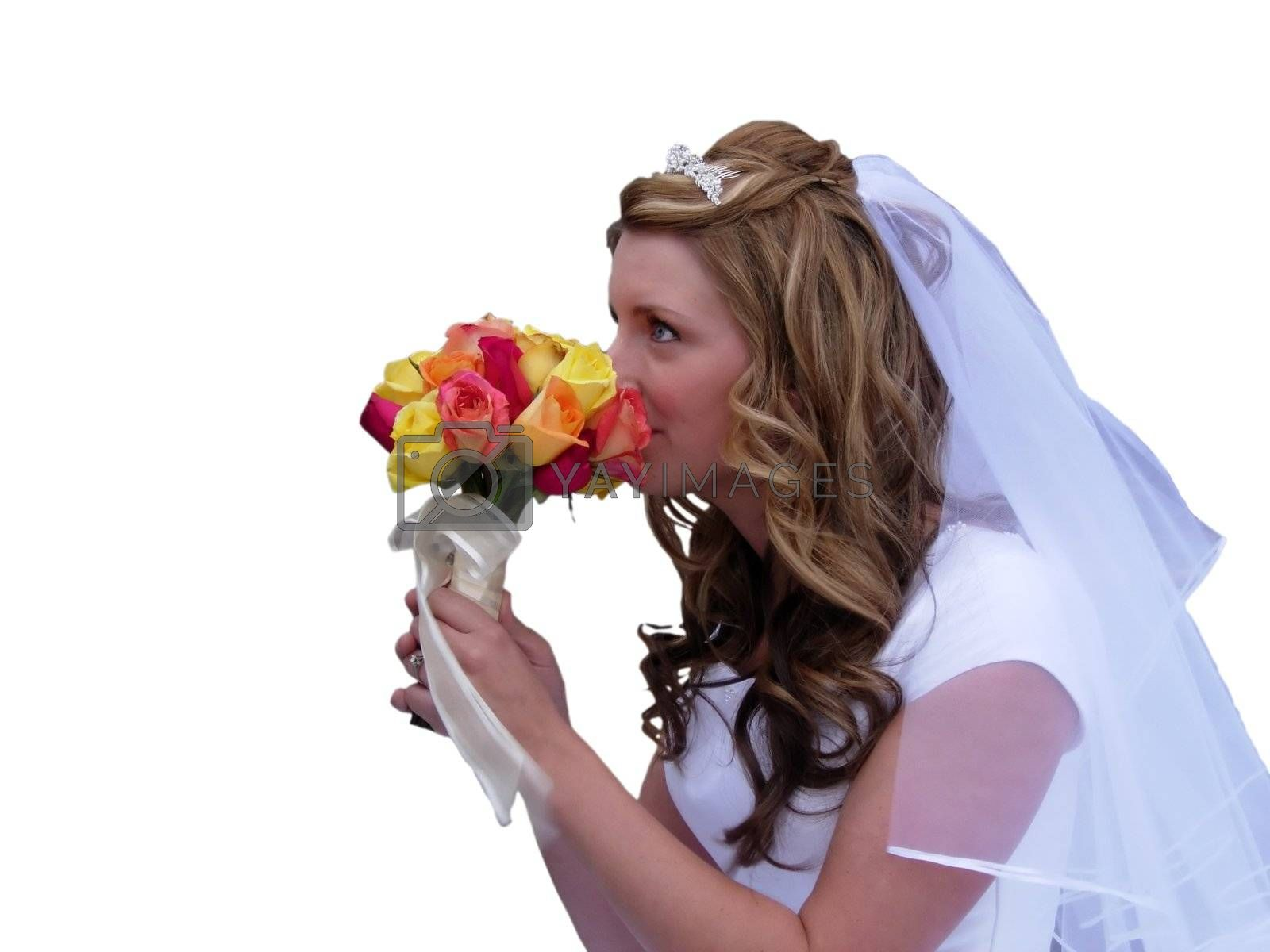 A young bride smelling her bouquet on a white background