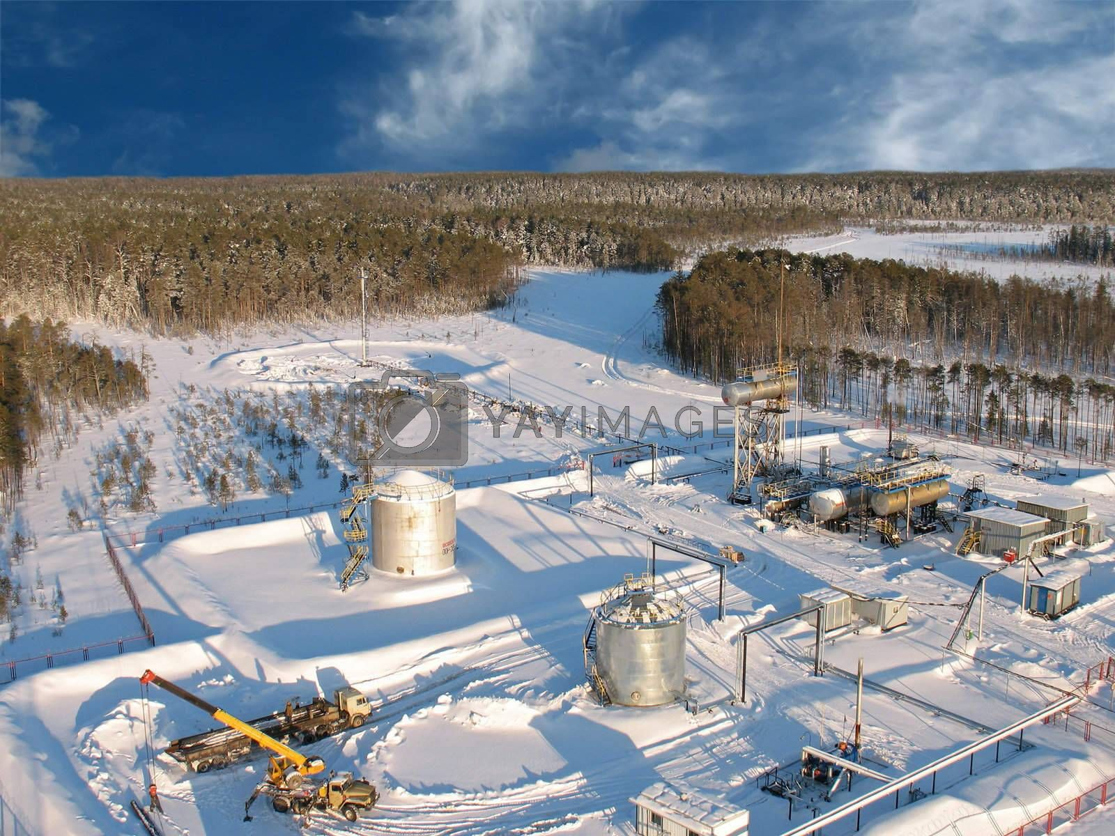Oil extraction. Oil industry. Construction and mechanism in work. Aerial view.