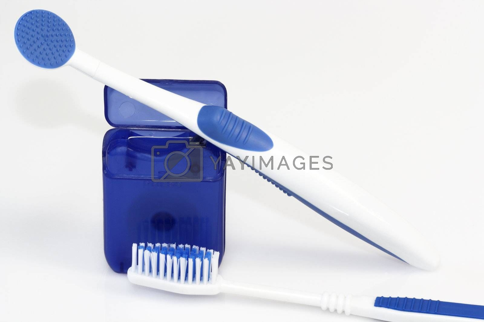 Dental care products on bright background
