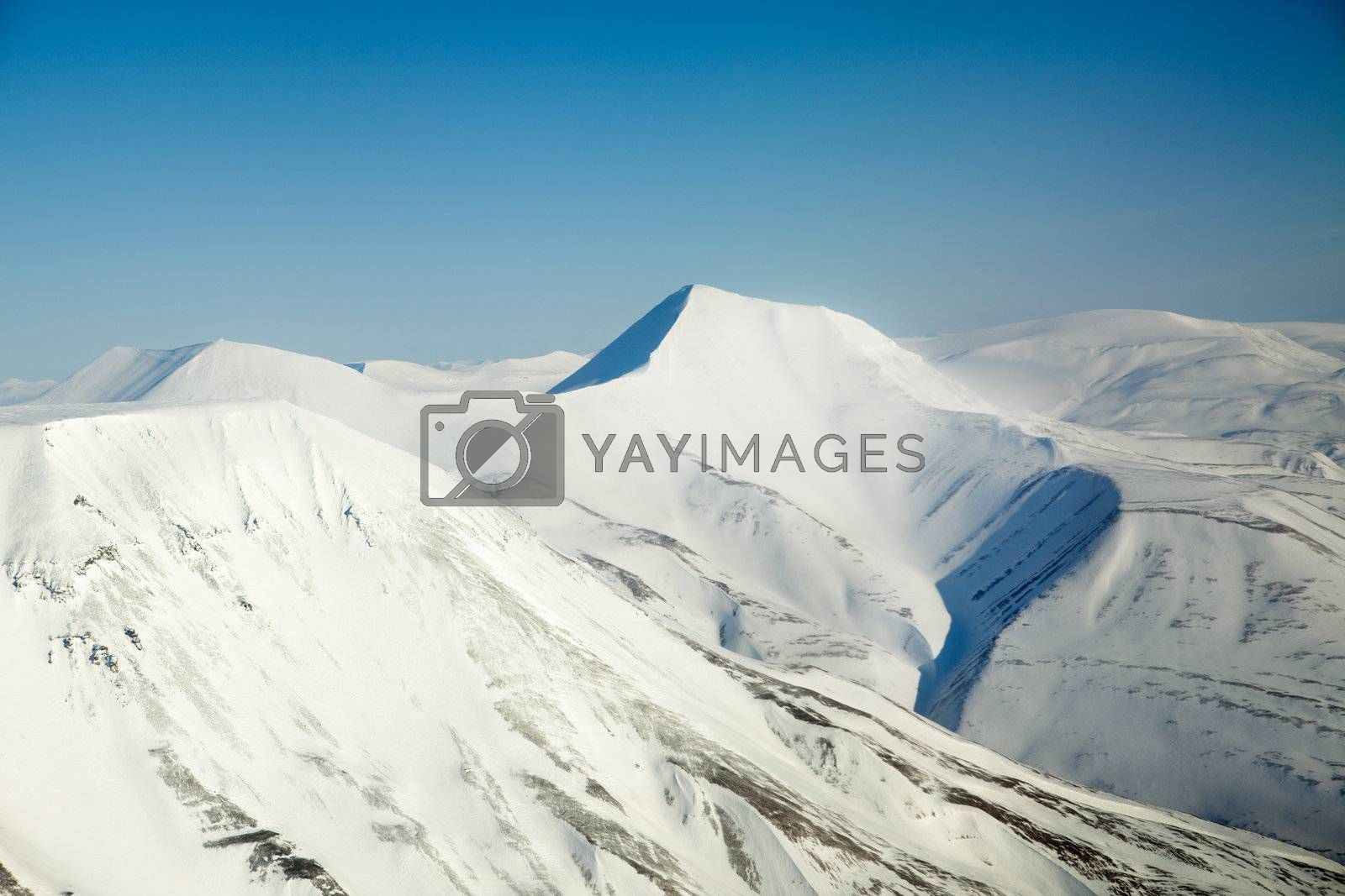A snow covered mountain range in Svalbard
