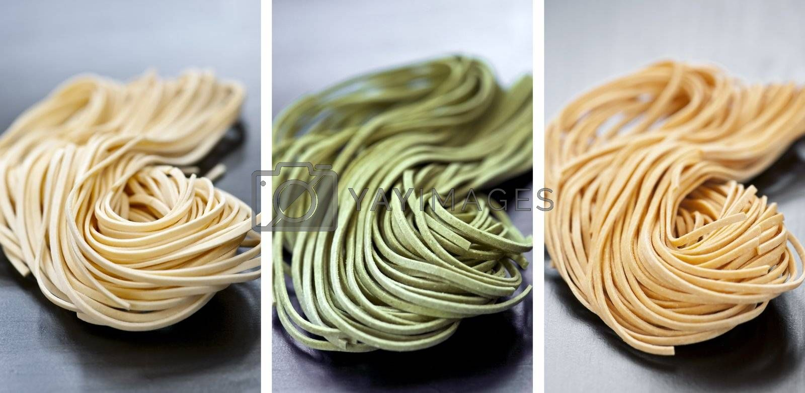 Assorted bundles of colorful raw tagliolini pasta noodles