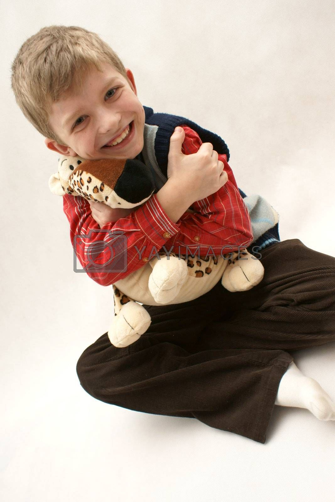 Young boy with toy plush