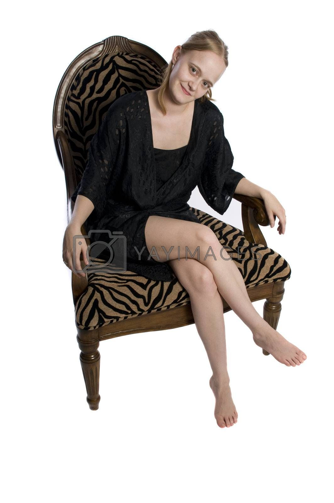 a young woman looking sexy in a big chair