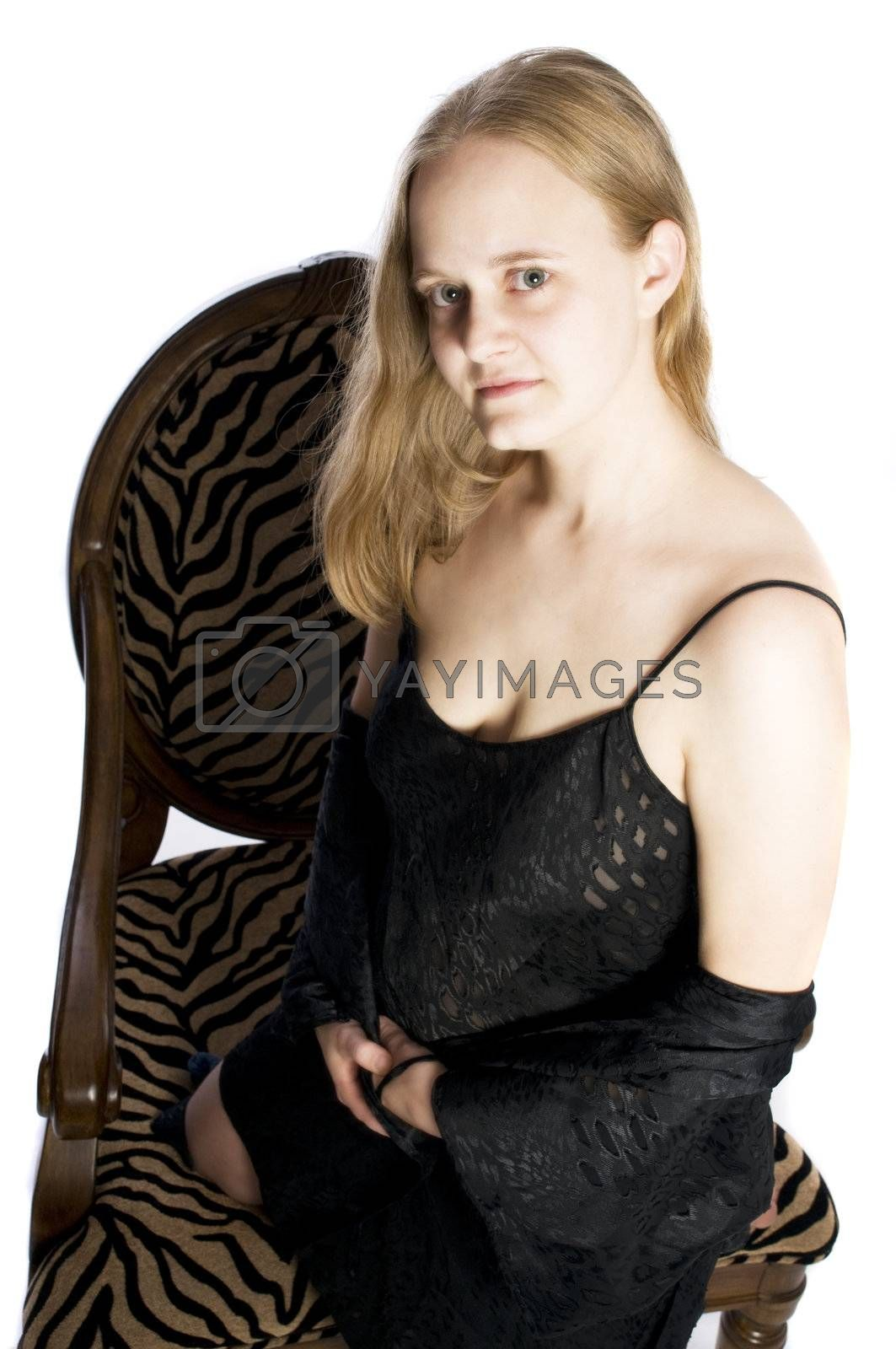 young woman in a chair looking sexy