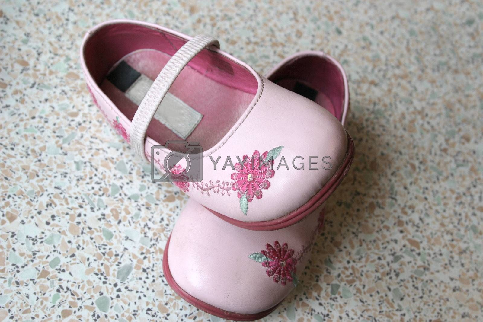 pair of pink decorated childrens shoes