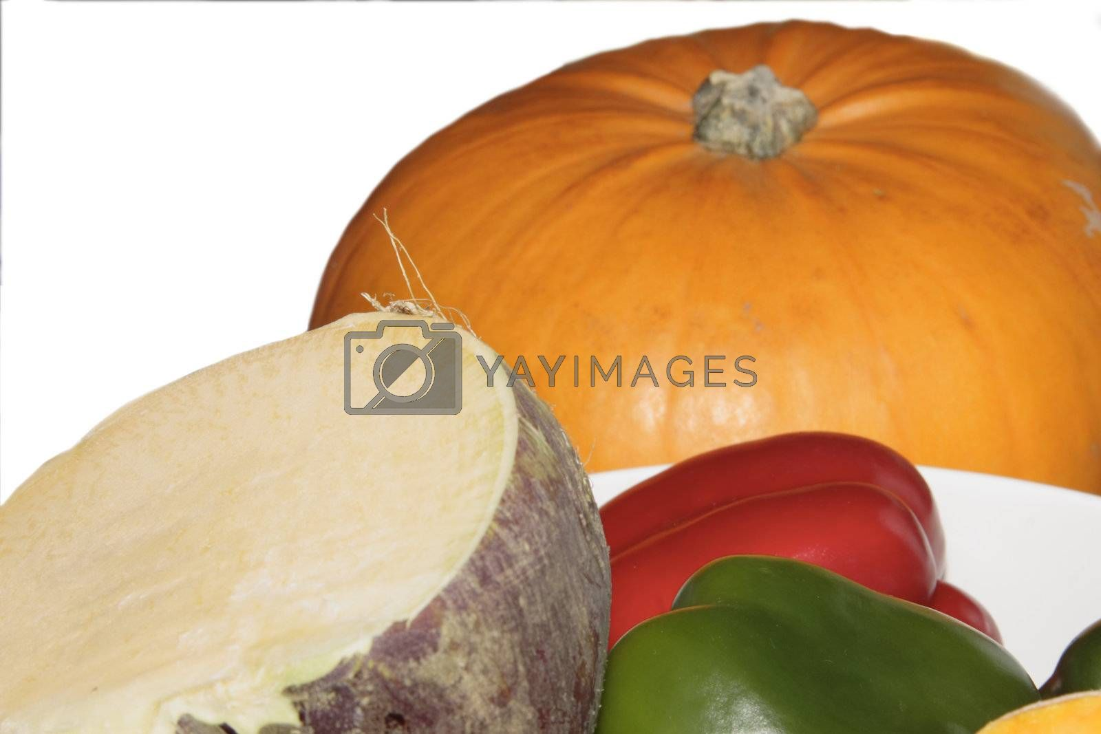 pumpkin swede and peppers against a white background