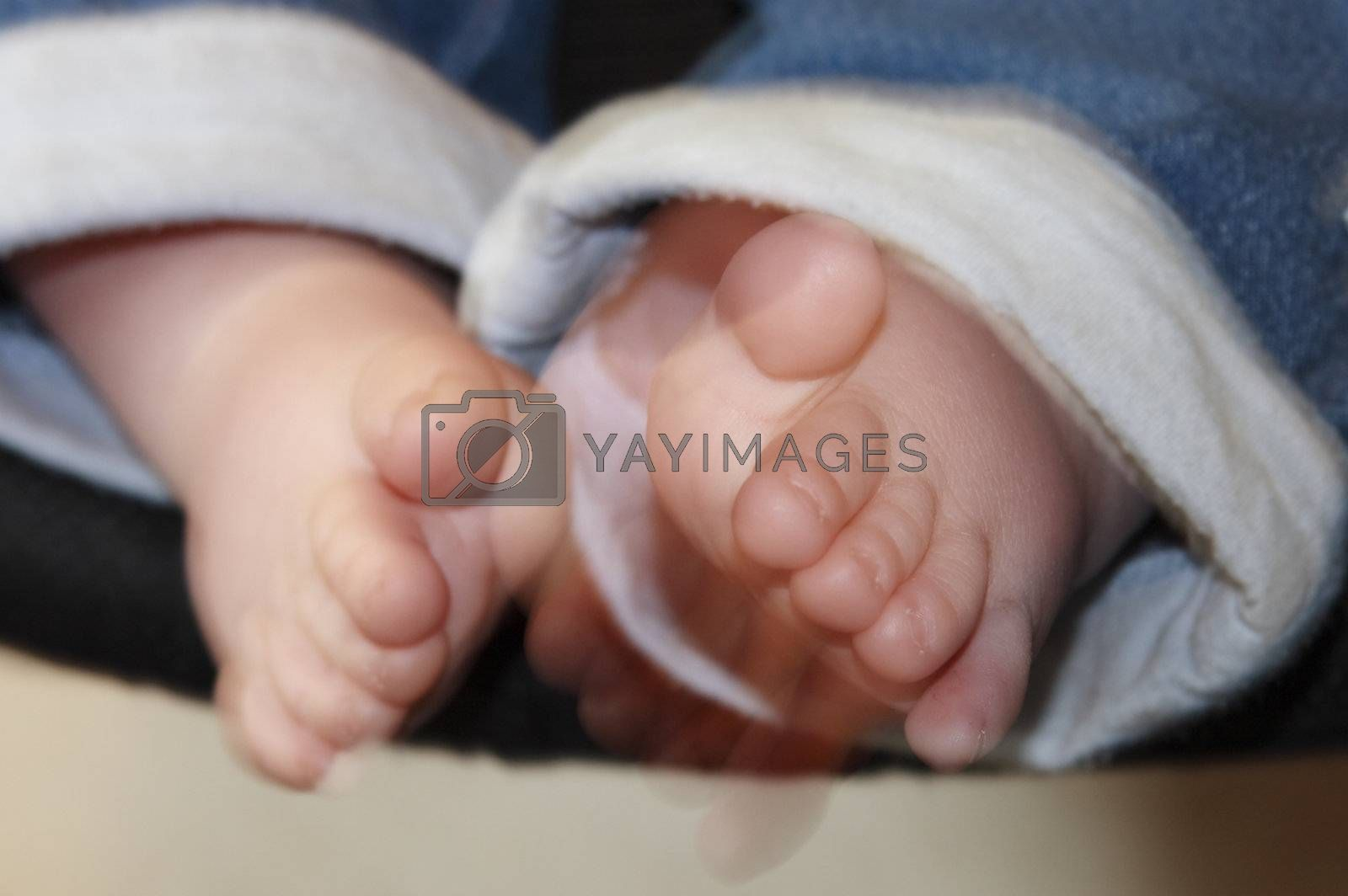 babies feet and toes showing movement as they are wiggled about