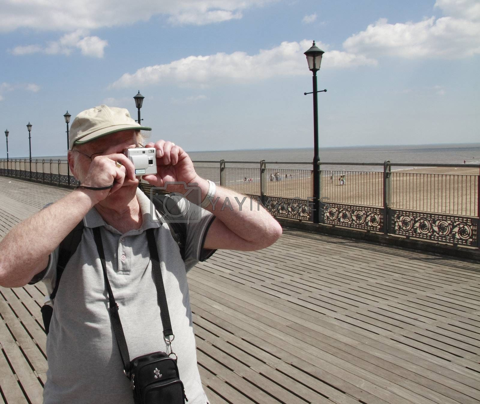 amateur photographer with his point and shoot camera taking snapshots
